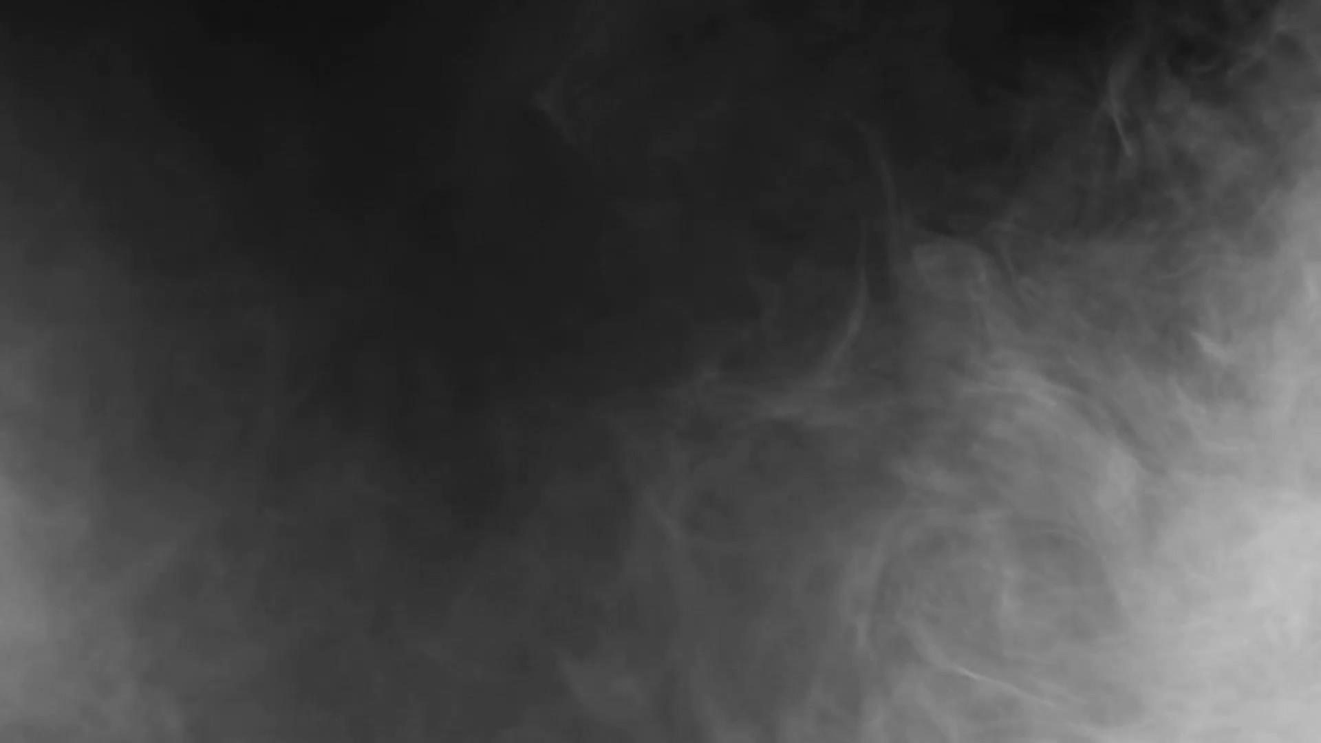 Abstract smoke on black background. Smoke cloud in slow motion. Smoke