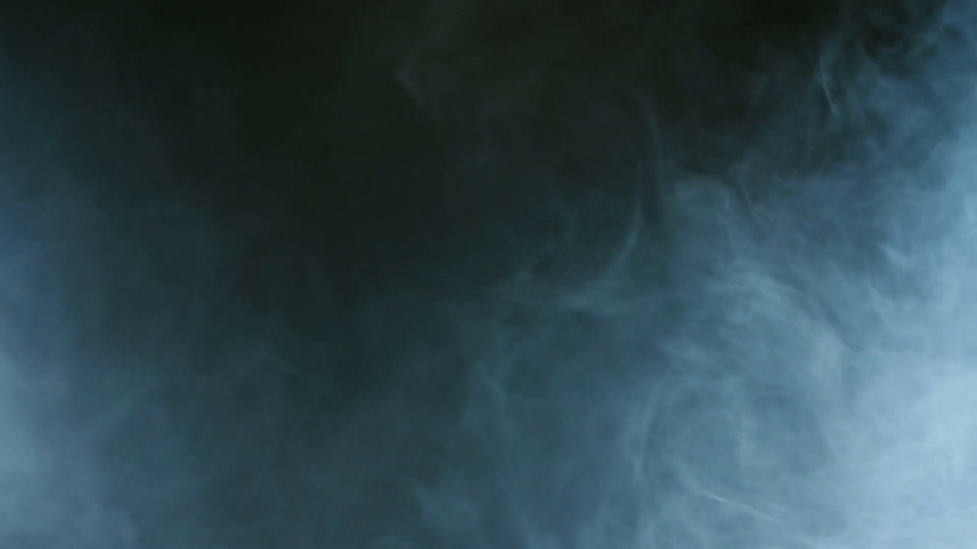 Blue smoke on black background. Cigarette smoke. Smoke effect. Fog  background. Abstract smoke cloud in slow motion. Smoke in studio blue light.