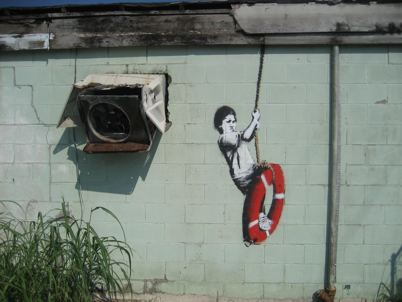Banksy graffiti art swinger in new orleans iron on t shirt transfer or  sticker
