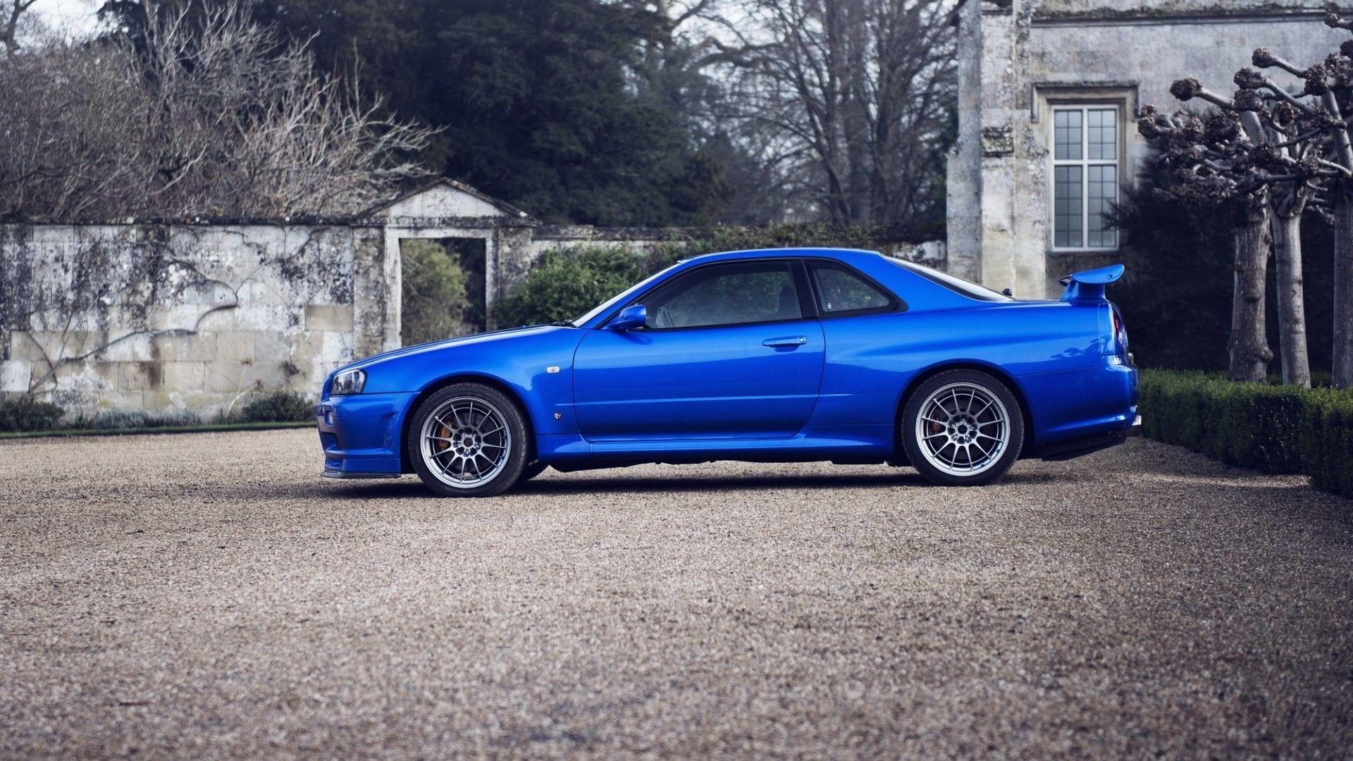 Cars parking rims blue cars Nissan Skyline GT-R r34 wallpaper .