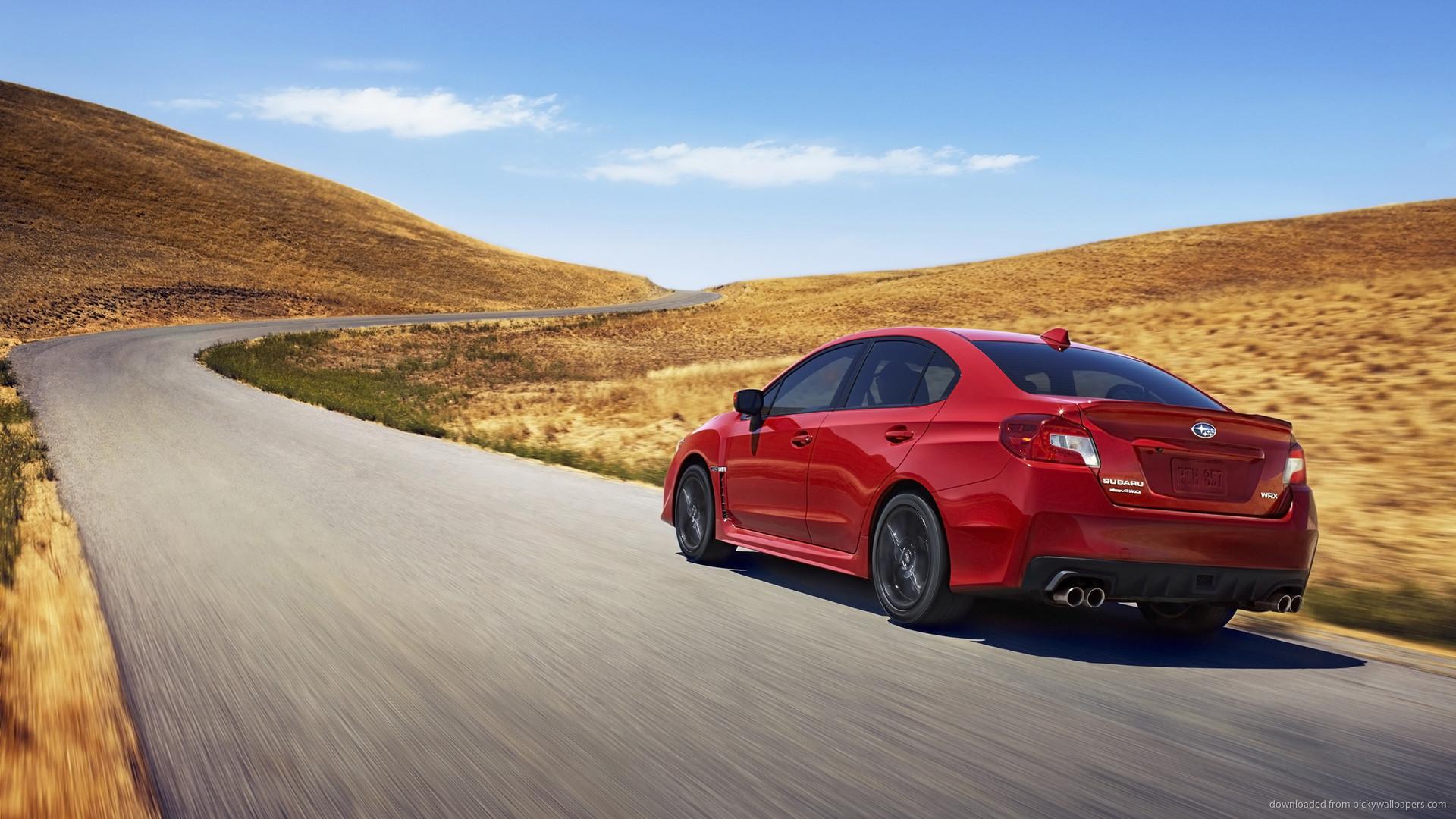 2015 Red Subaru WRX STI Rolling Shot Wallpaper picture