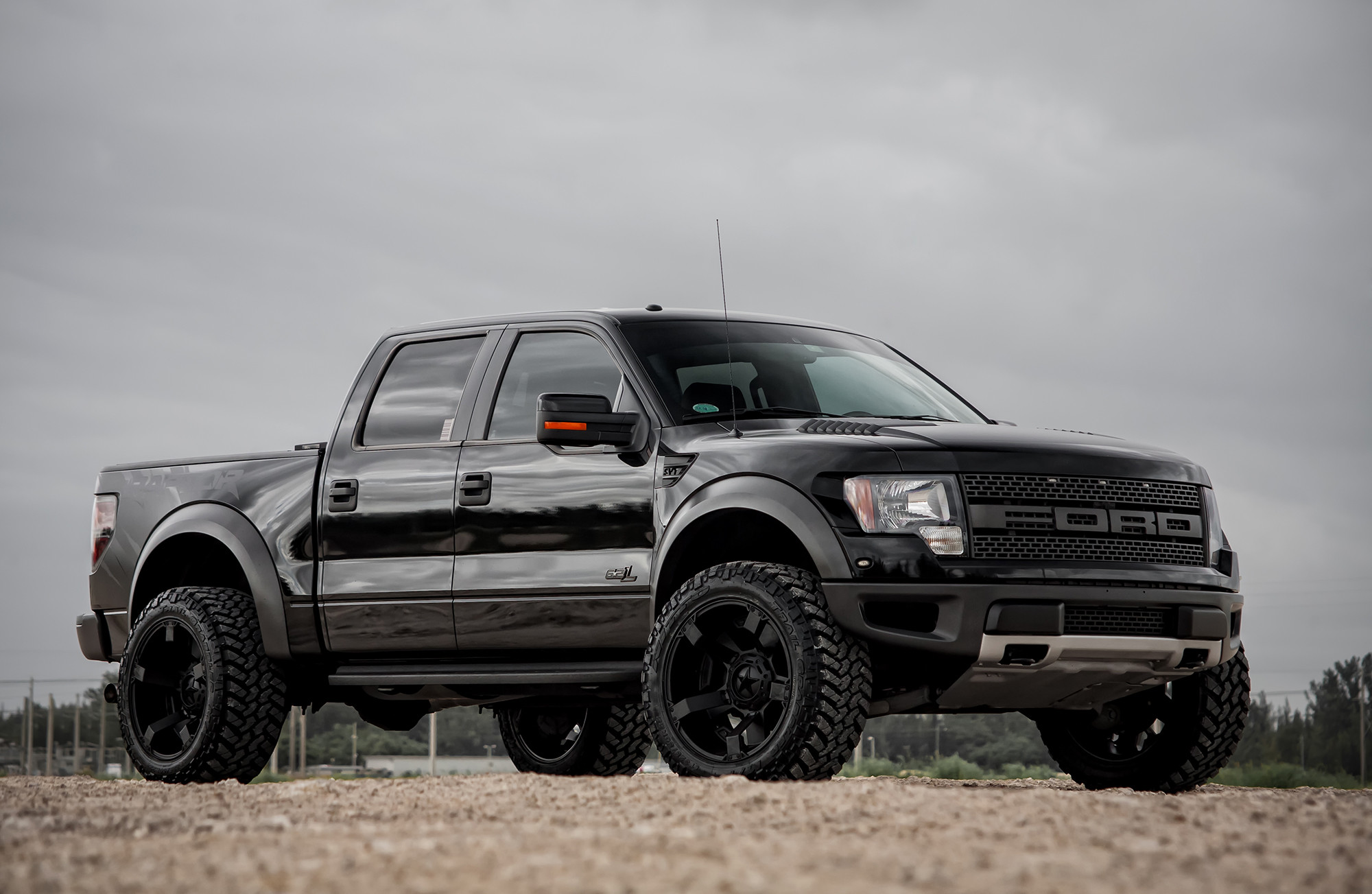 Customized Ford SVT Raptor Black With Suspension Leveling Wallpaper  Wallpaper