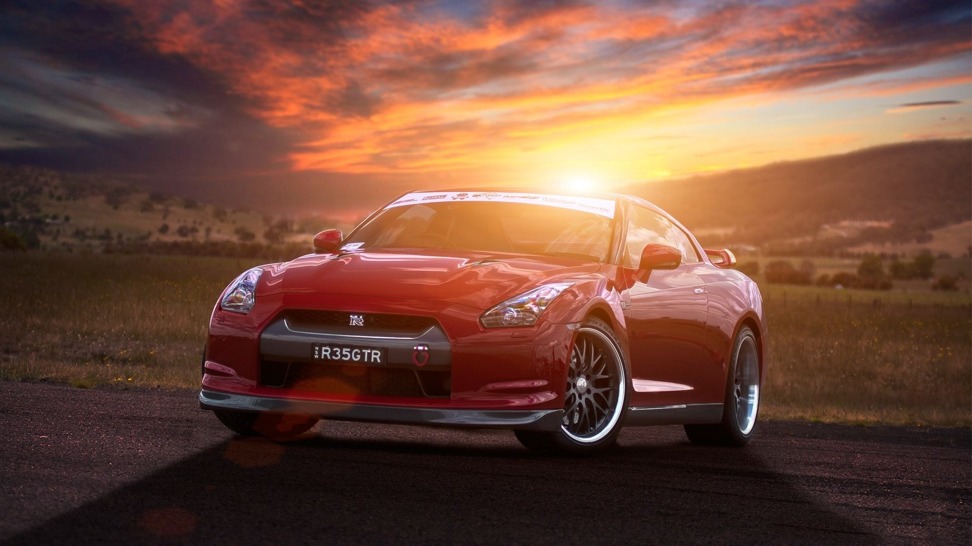 Nissan GT-R R35 red supercar at sunset 4k HD wallpaper
