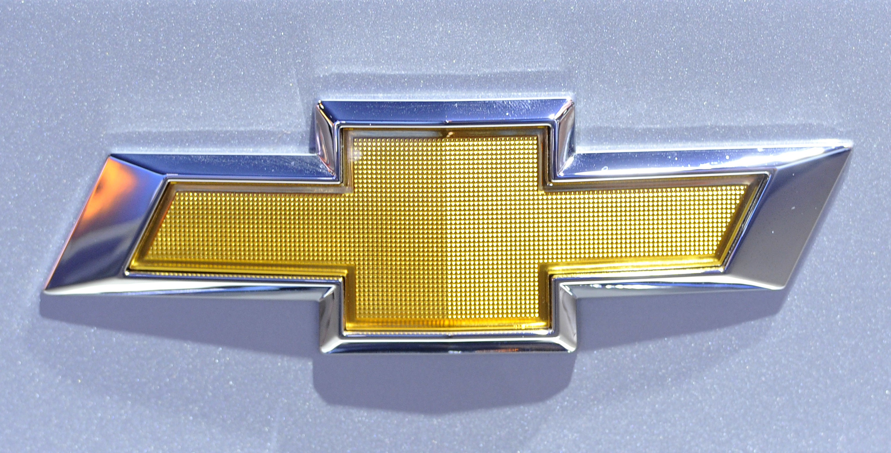 The logo for Chevrolet on display at the Chicago Auto Show