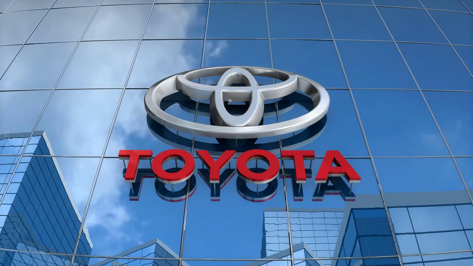 Editorial, Toyota logo on glass building. Motion Background – VideoBlocks