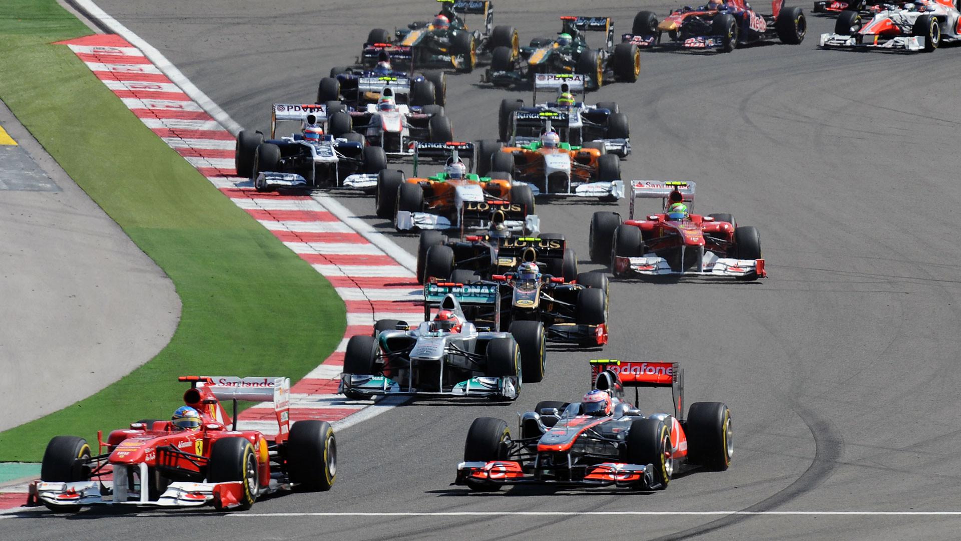 First corner after start several F1 cars …