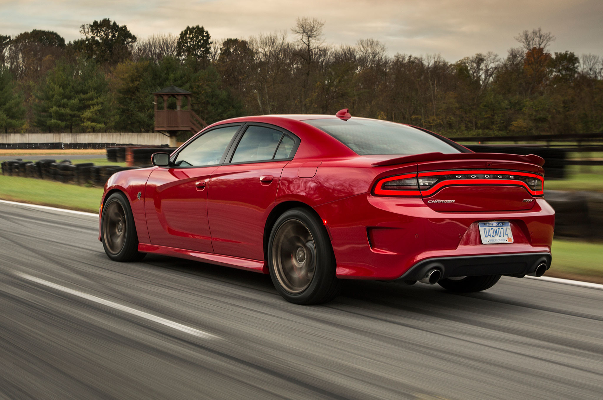 2015 dodge charger srt hellcat rear three quarter view in motion 9
