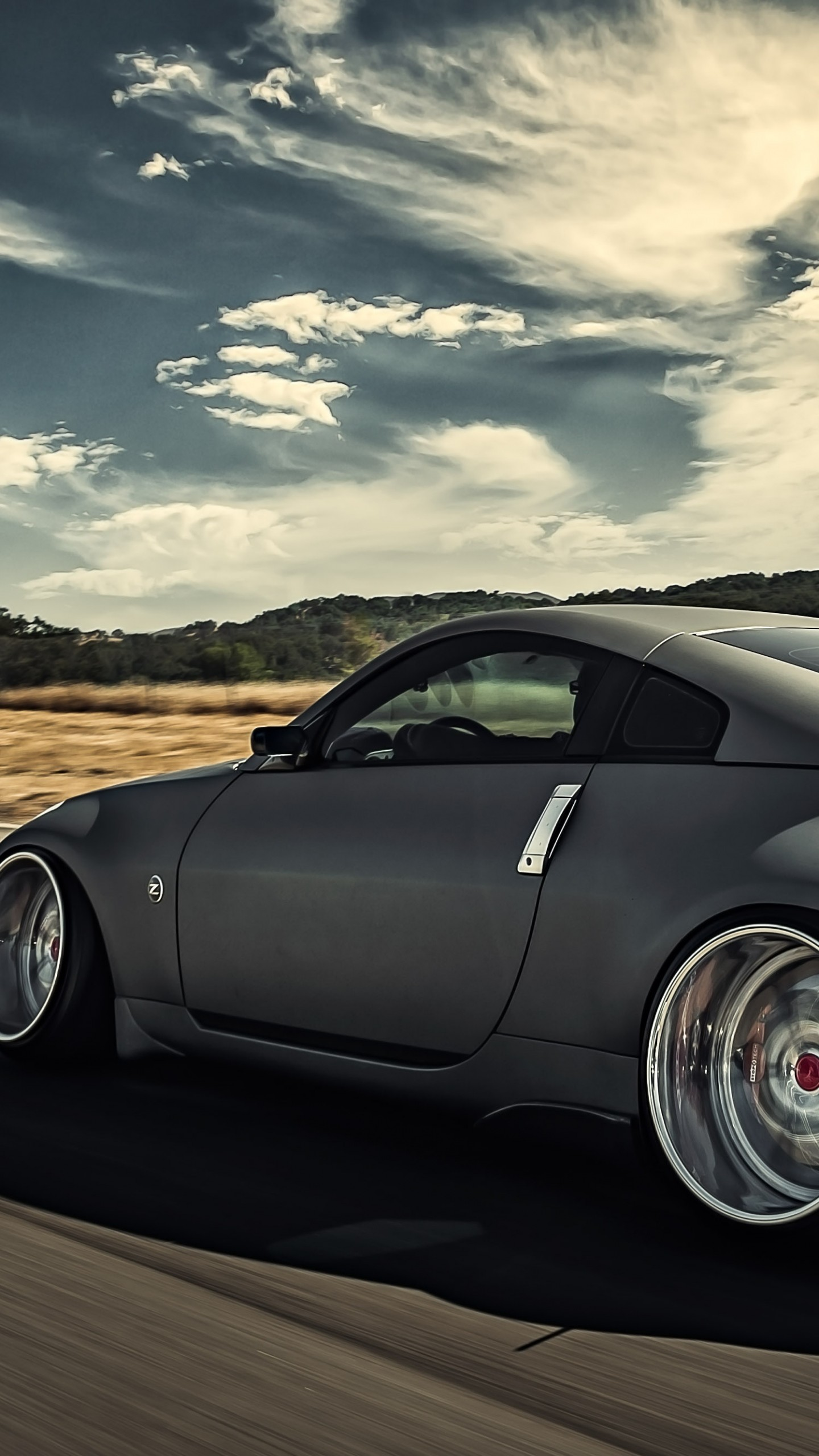Preview wallpaper nissan, 350z, stance, movement, speed, side view 1440×2560