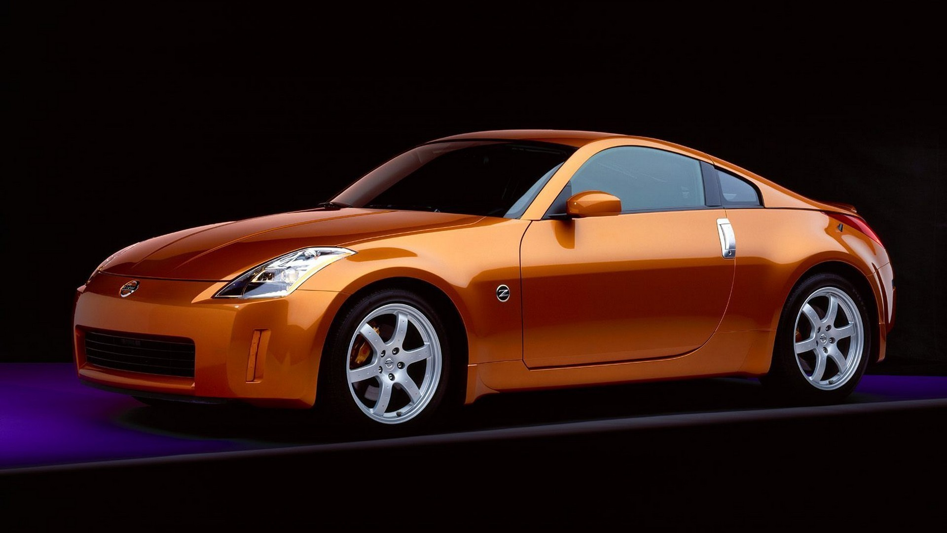 Orange Nissan 350Z on a black background