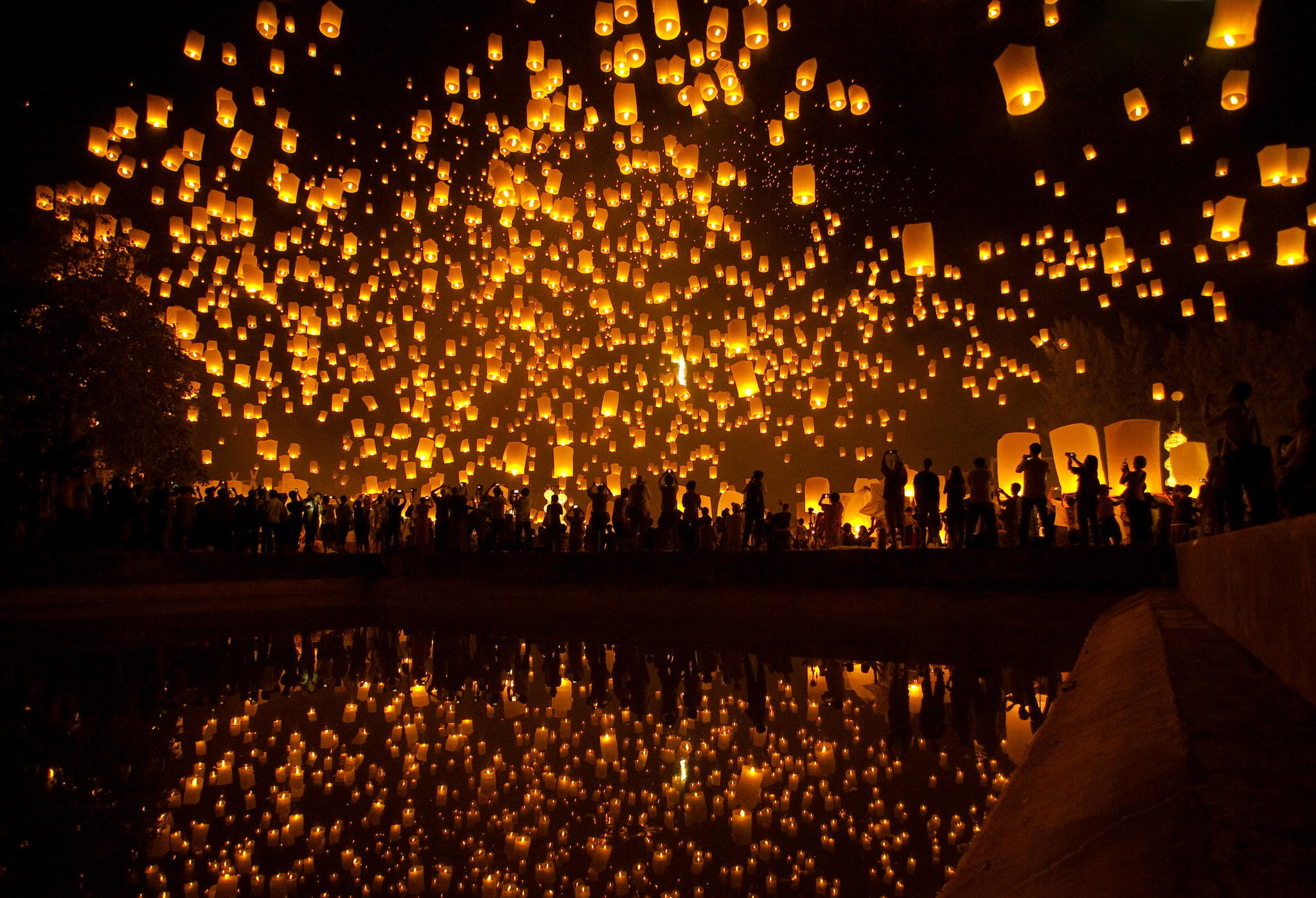 Thousands of lanterns take to the night sky in a lantern festival in  Thailand.