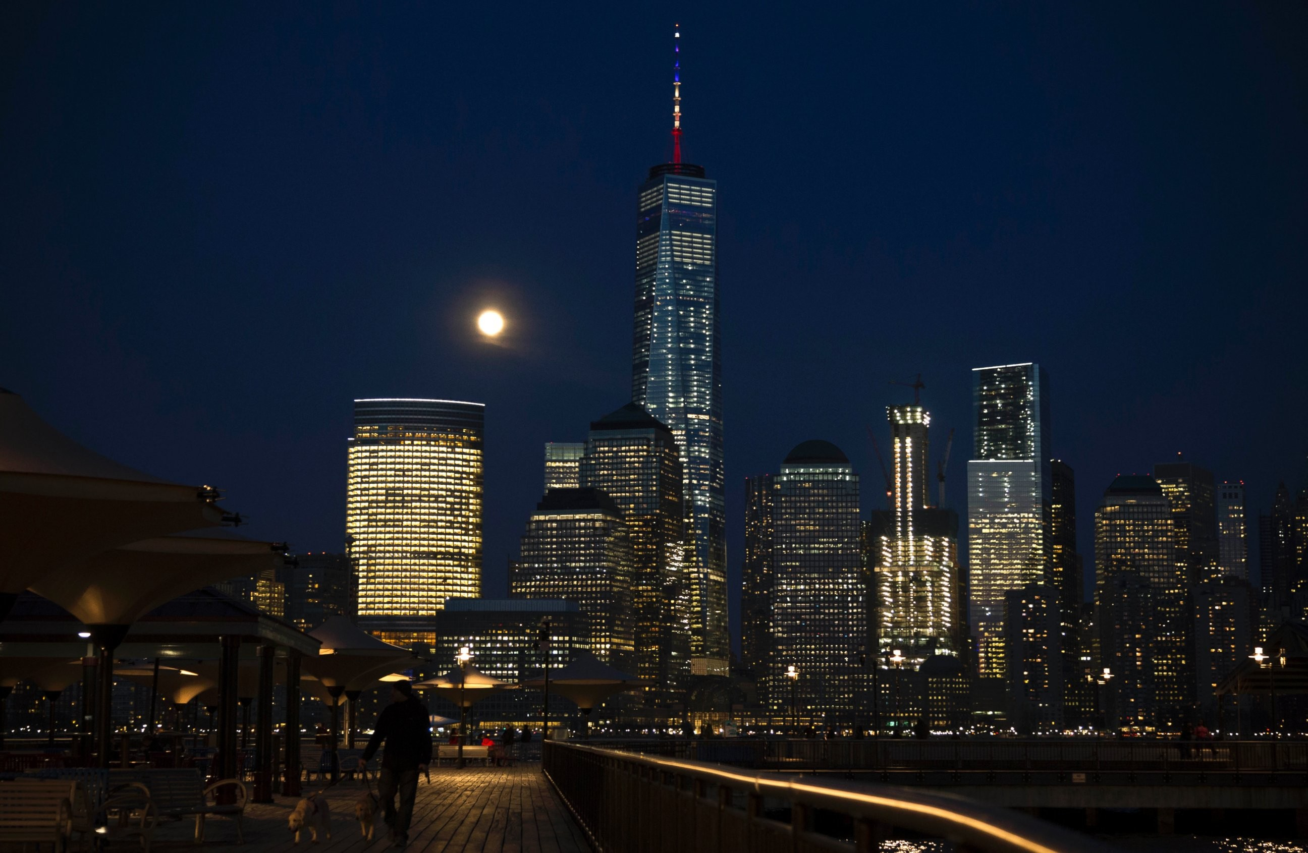PHOTO: The full moon rises behind One World Trade Center …