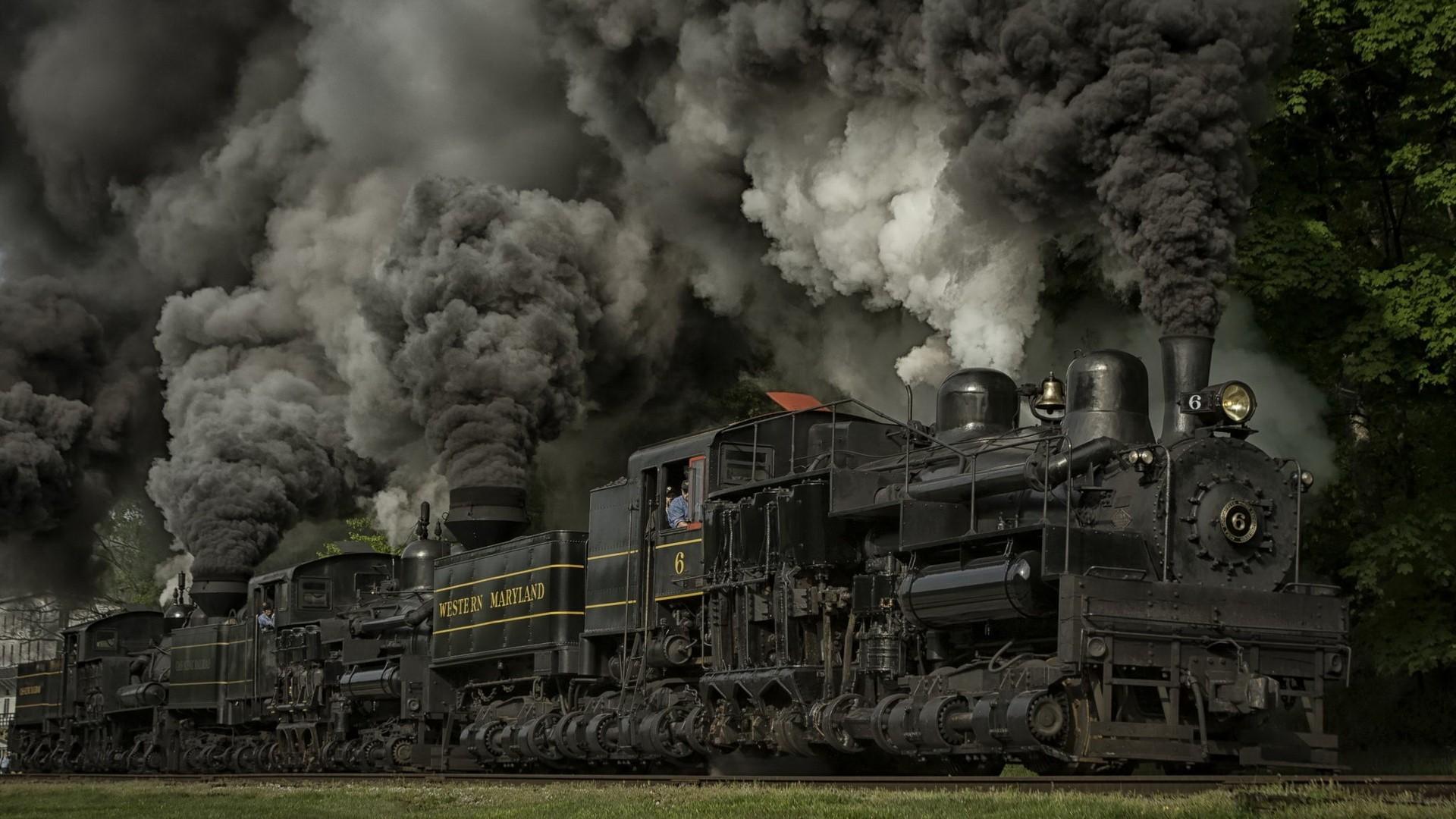 Steam locomotive in the cloud of black smoke