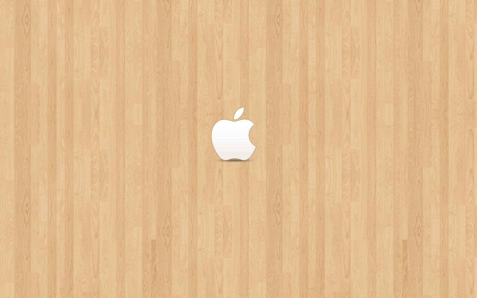 Apple on light brown wood