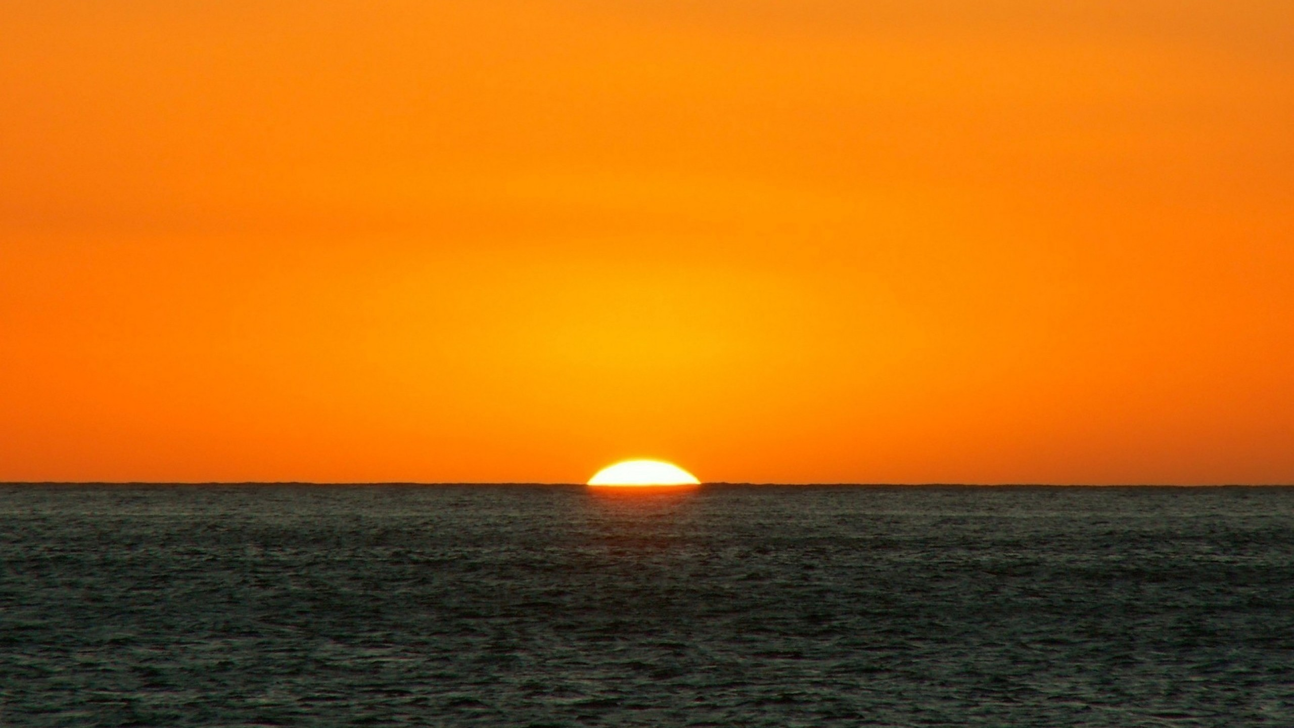 Wallpaper orange, dark blue, sea, horizon, sun