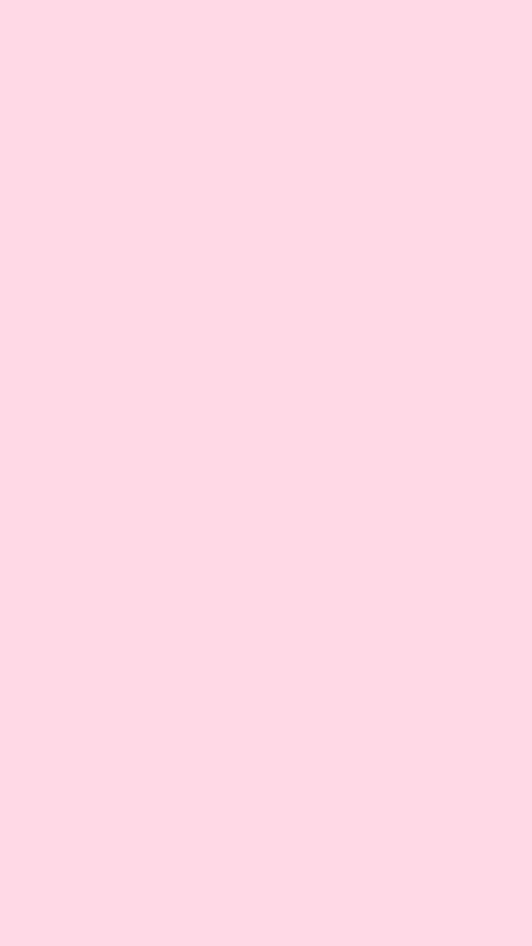 Plain baby pink wallpaper