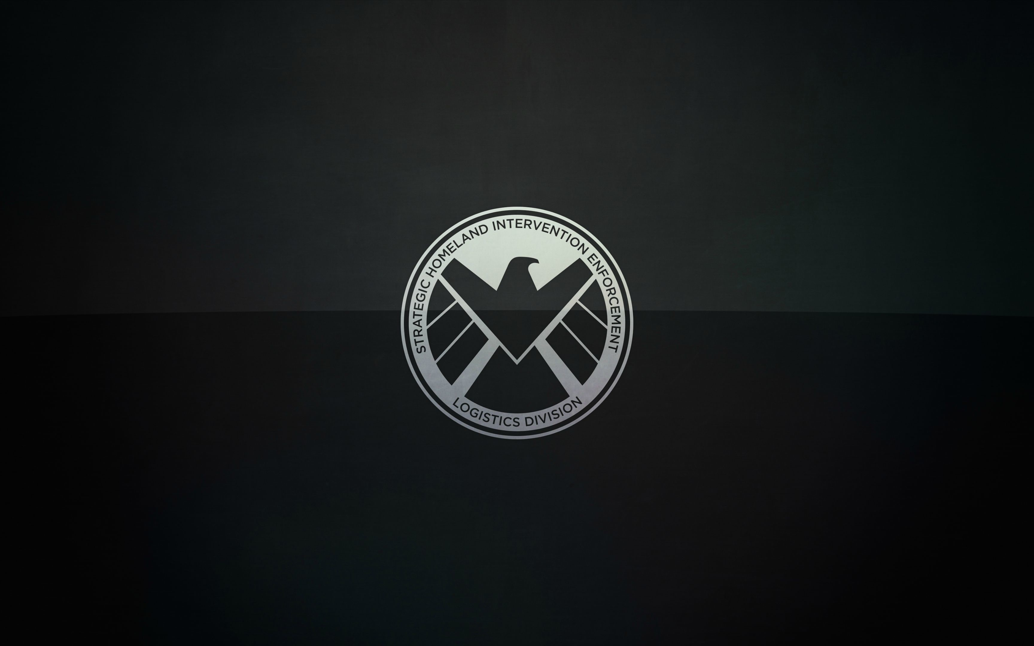 Could someone remove the color gradient from the background of this  wallpaper? Just take the logo and drop it on a solid dark gray/black  background.