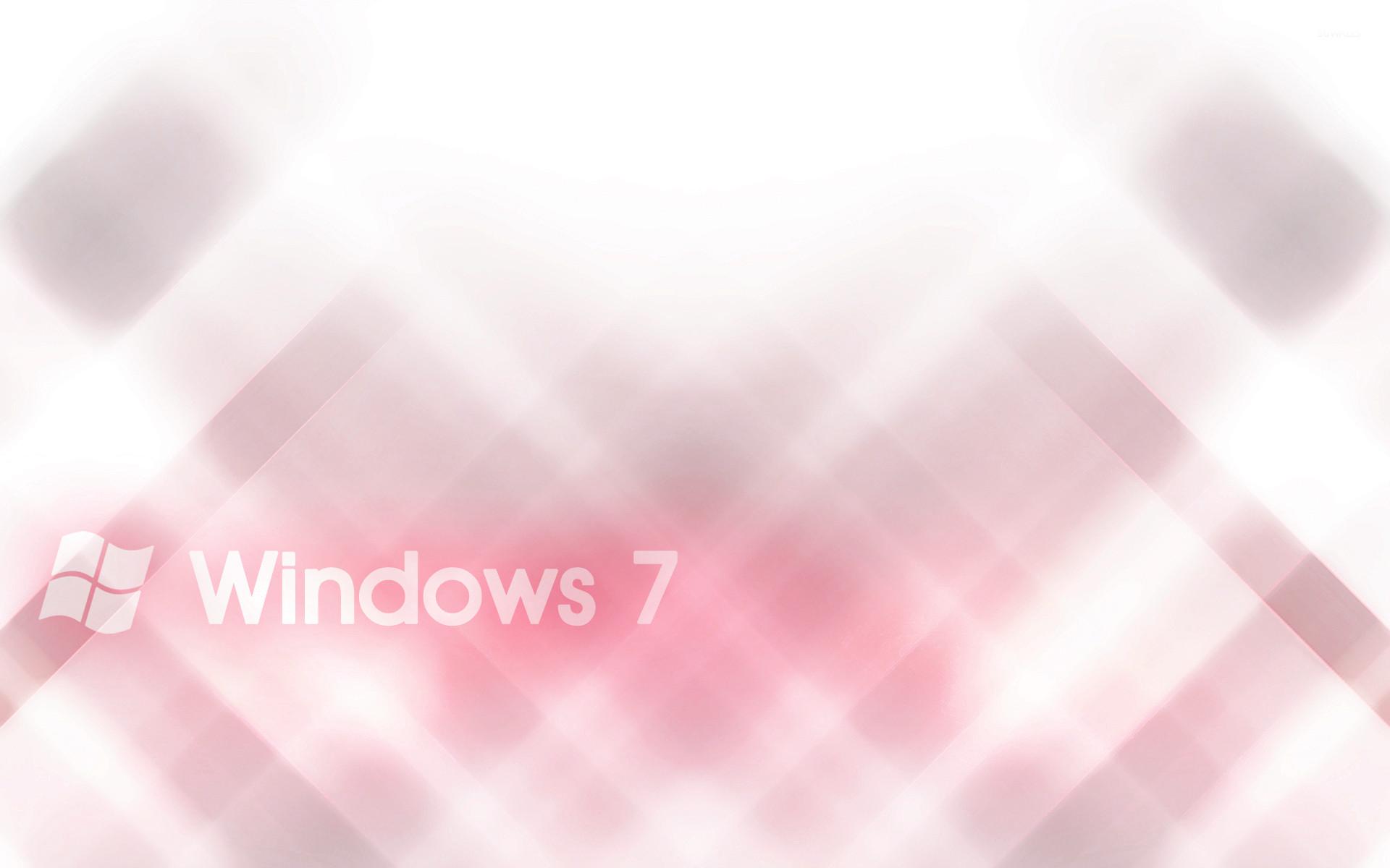 White Windows 7 on pink blur wallpaper