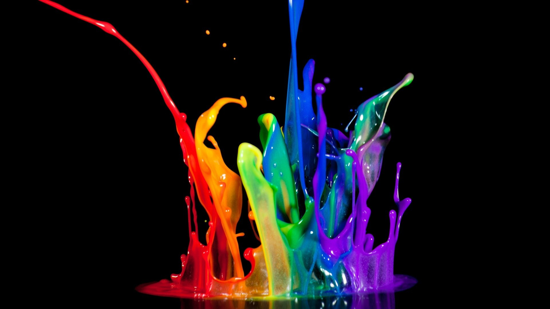 Colorful paint splash in black background