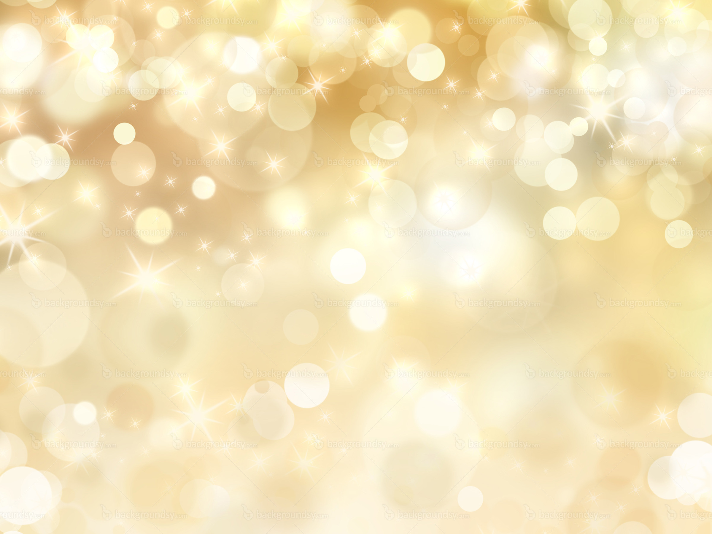 Abstract yellow sparkles background, defocused light particles on soft  yellow background.