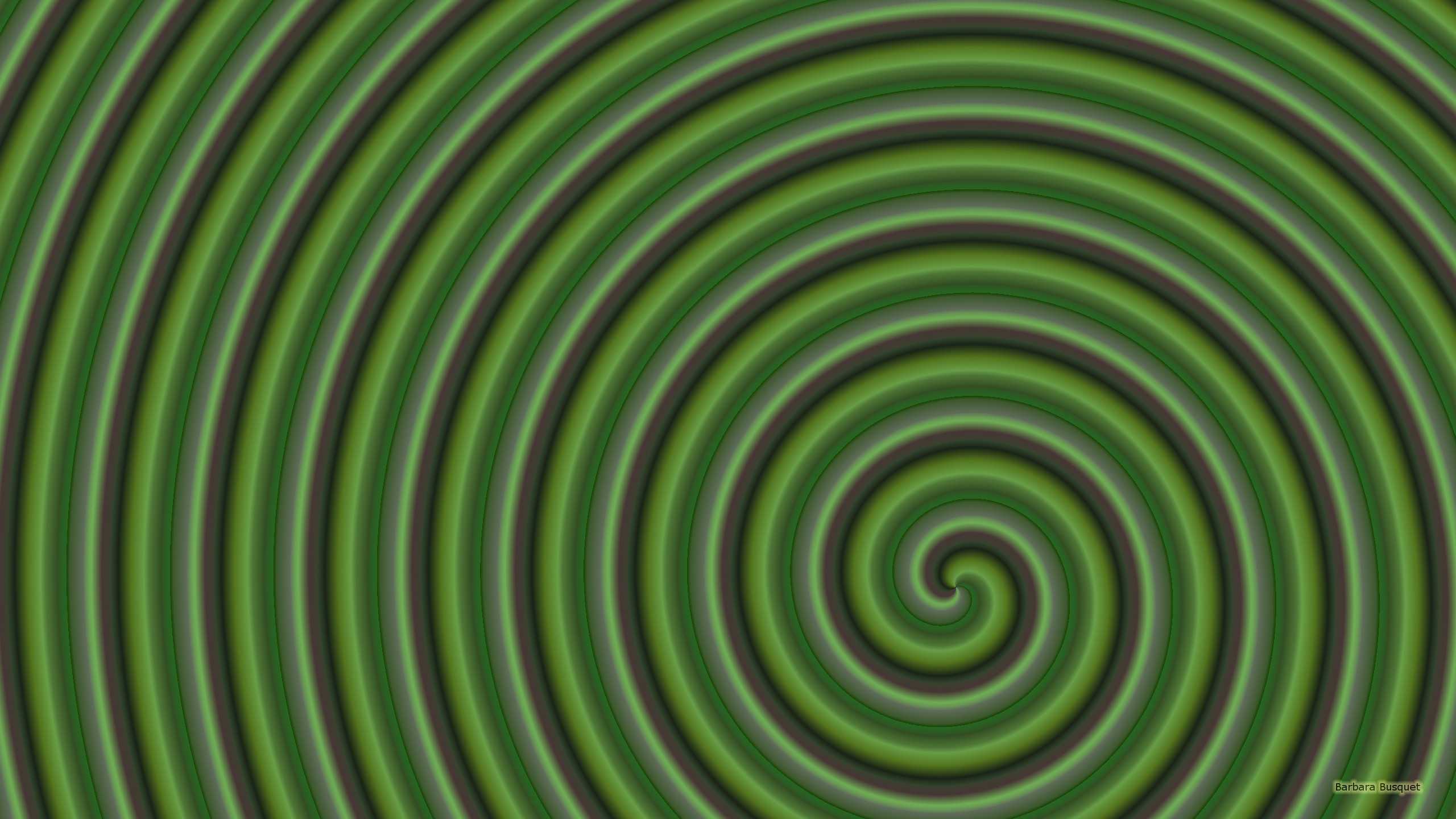 Spiral pattern wallpaper in the color green.