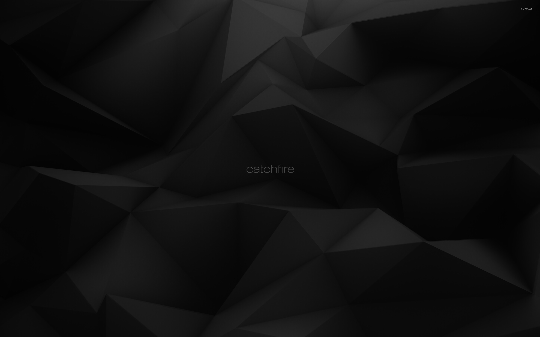 Catchfire on dark gray polygons wallpaper