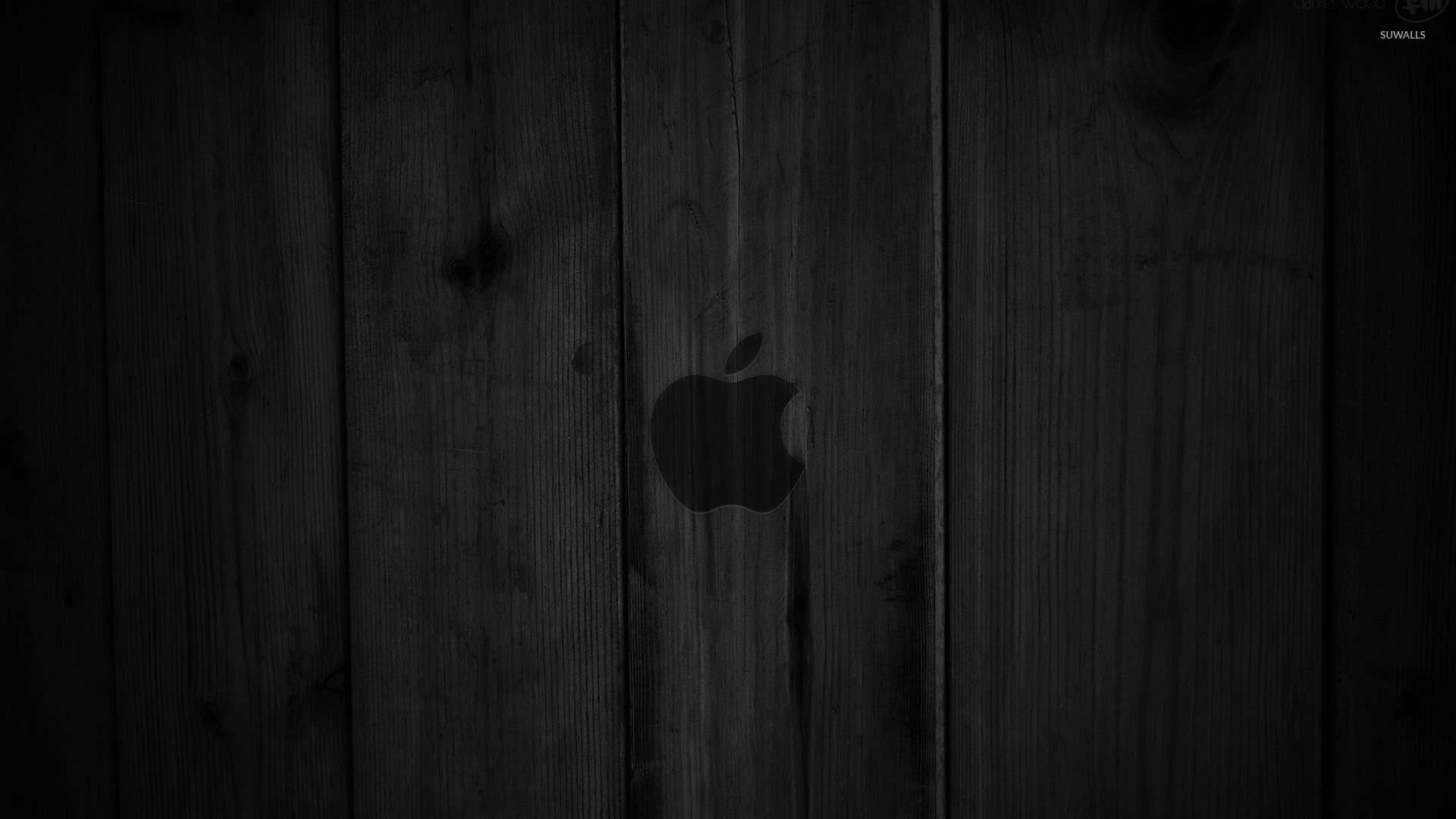 Dark gray Apple on the wooden panels wallpaper