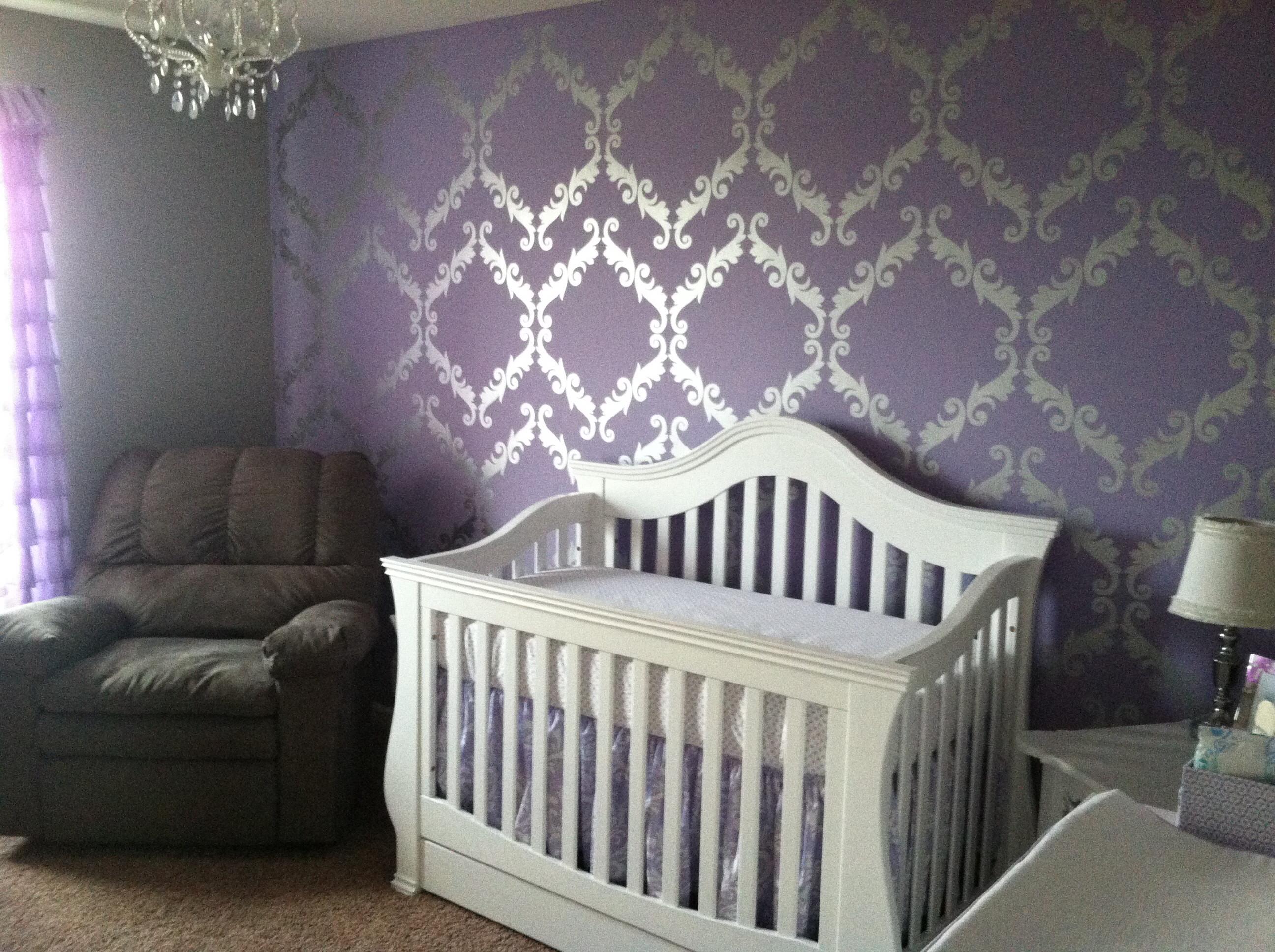 Purple, metallic silver and white baby girl's nursery