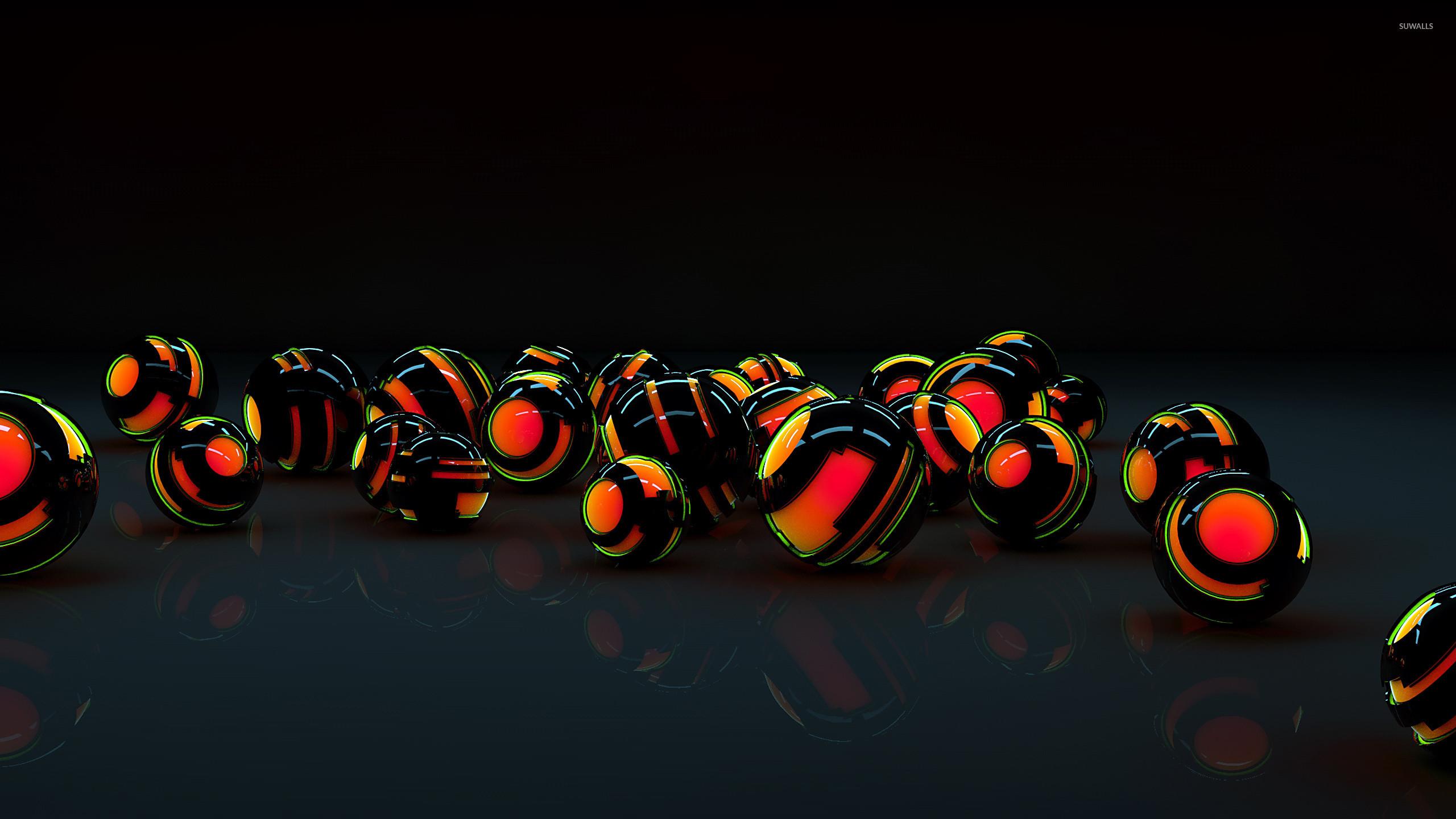 Black shells protecting the orange orbs wallpaper