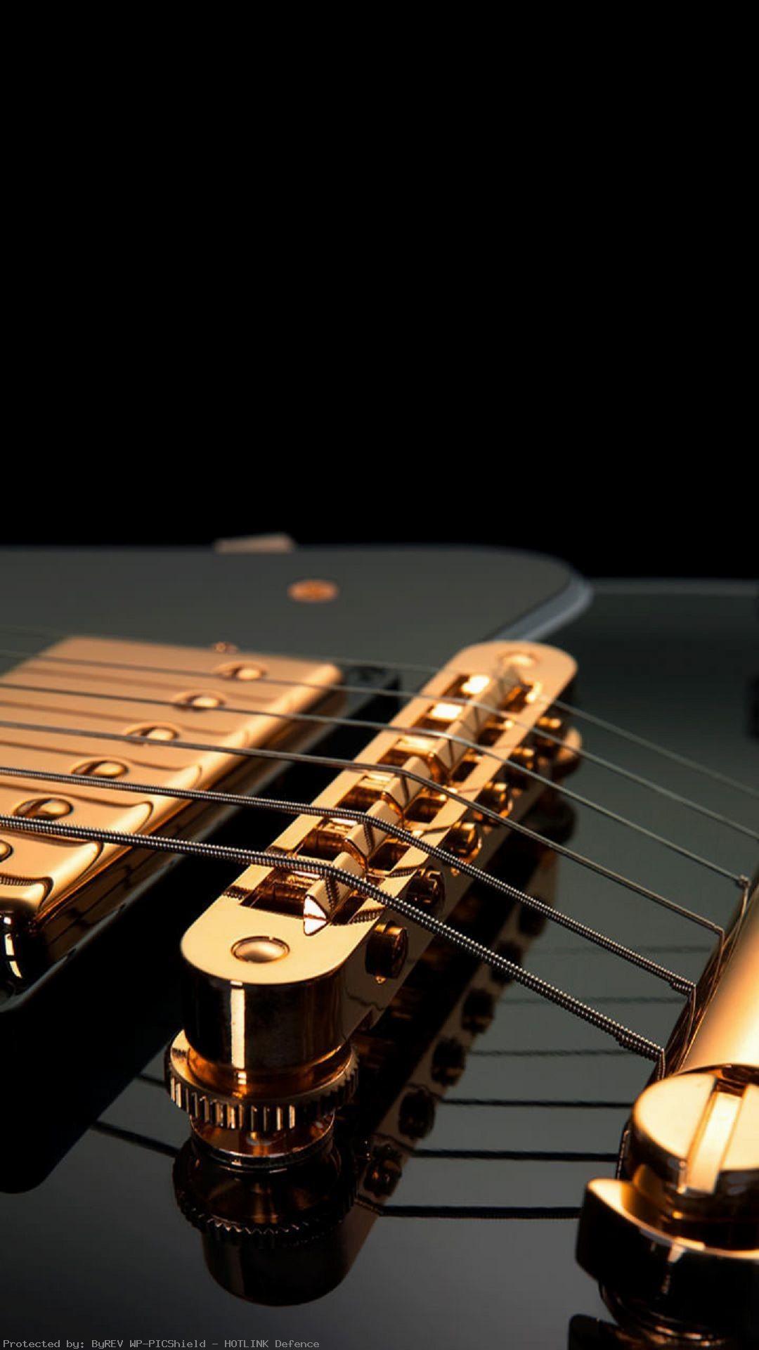 guitar-strings-black-gold-image-1080%C3%971920-