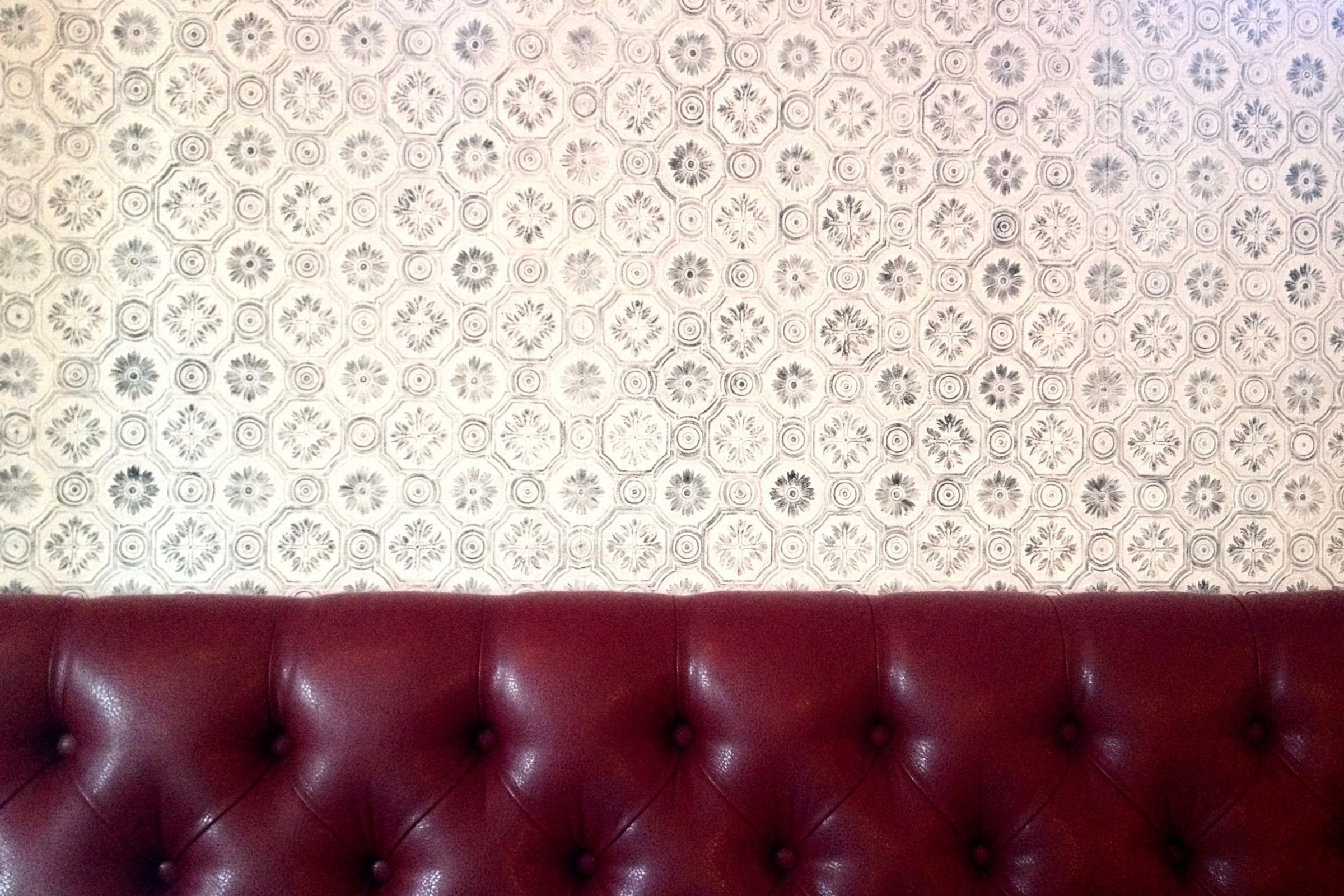 Red Vinyl Seat on Patterned Wallpaper