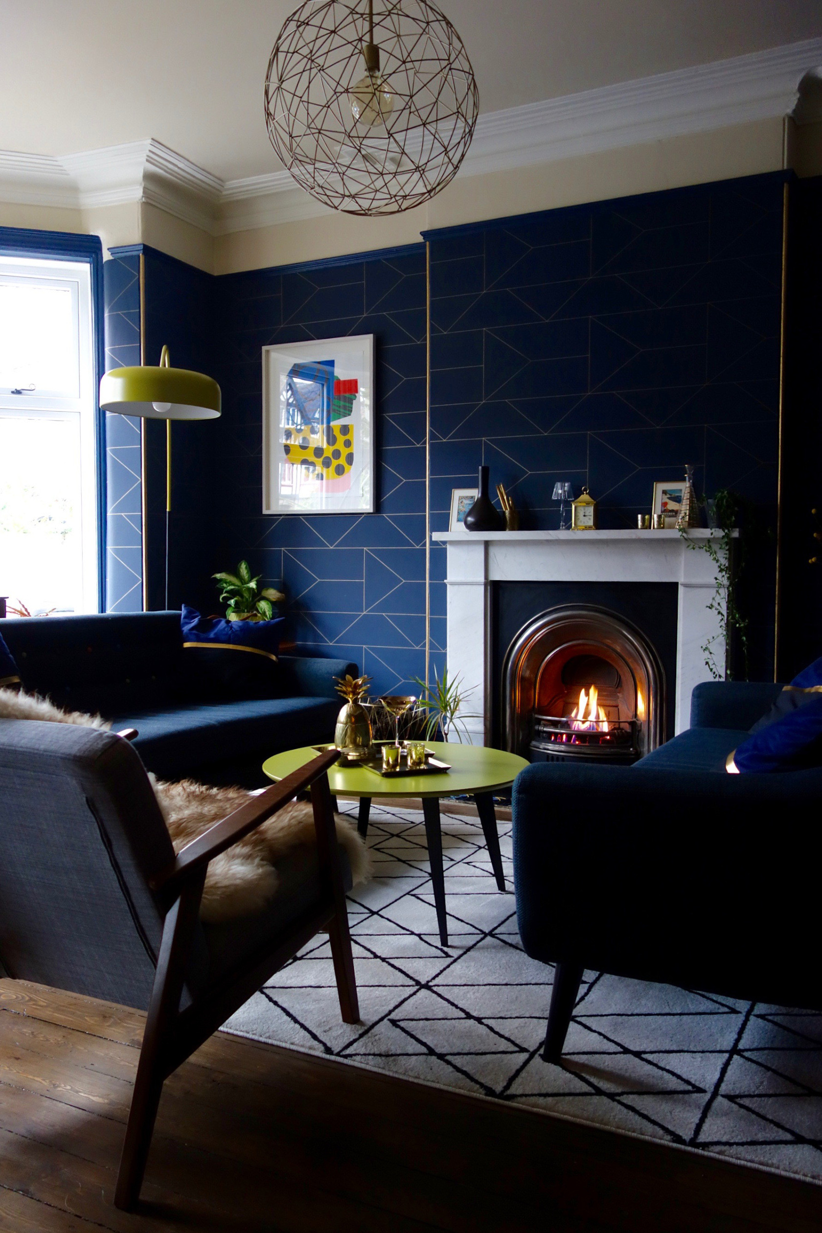 navy blue and gold wallpaper set off this pendant light perfectly image by  Karen Knox