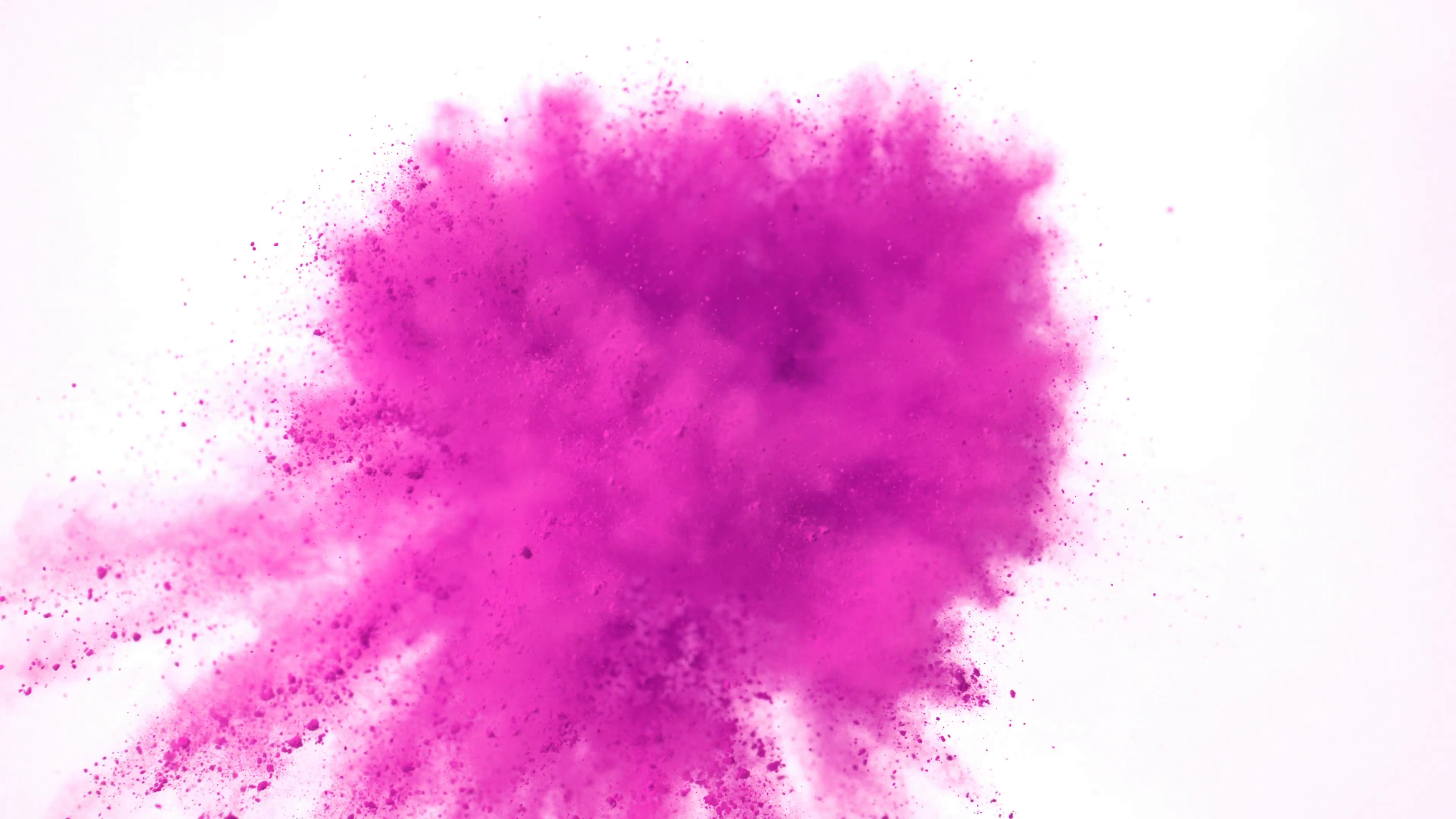 Subscription Library Heart shaped colorful powder/particles fly after being  exploded against white background. Slow Motion