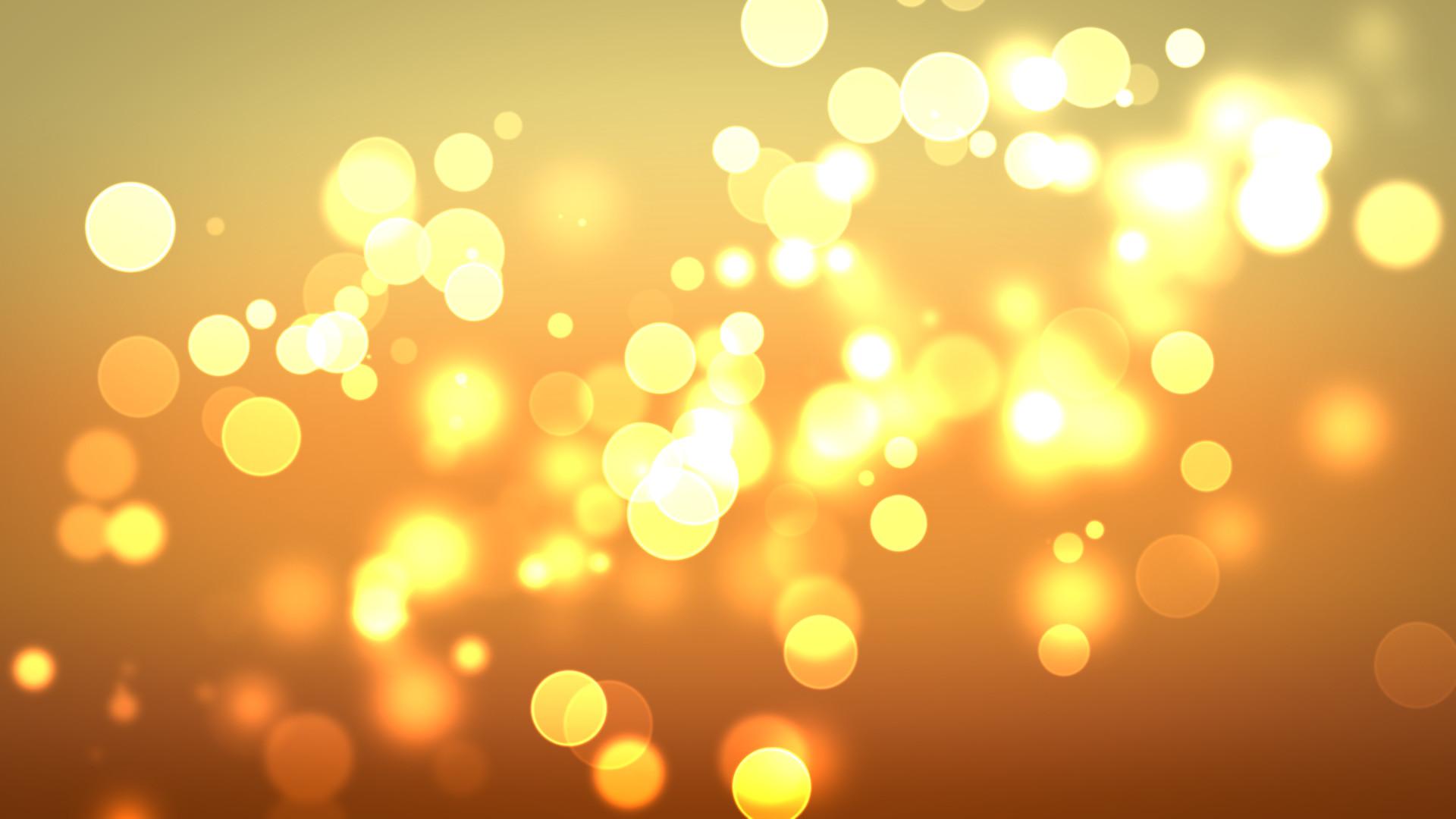 Download Golden circles of light wallpaper