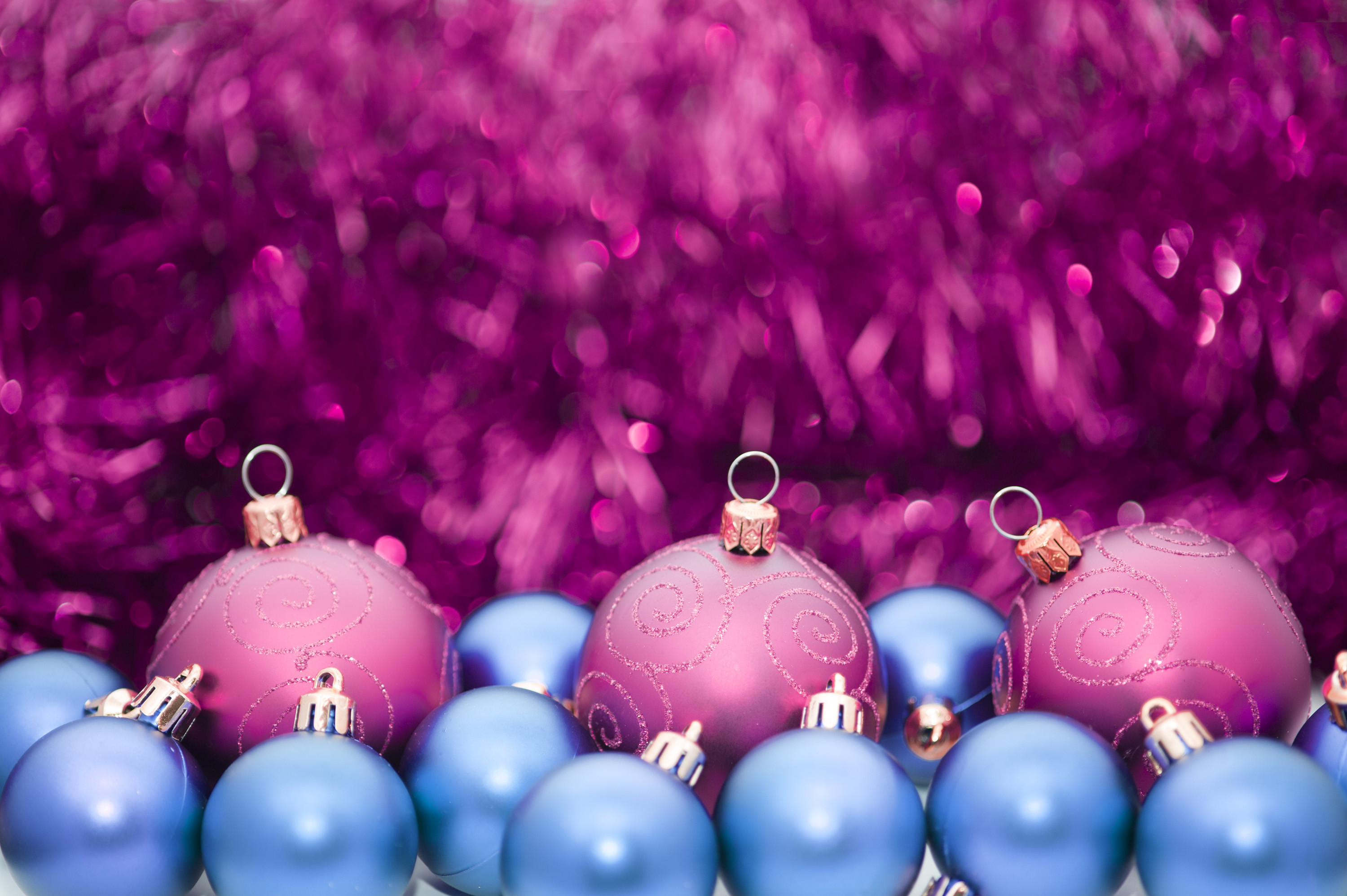purple and blue baubles with an out of focus sparkling tinsel background