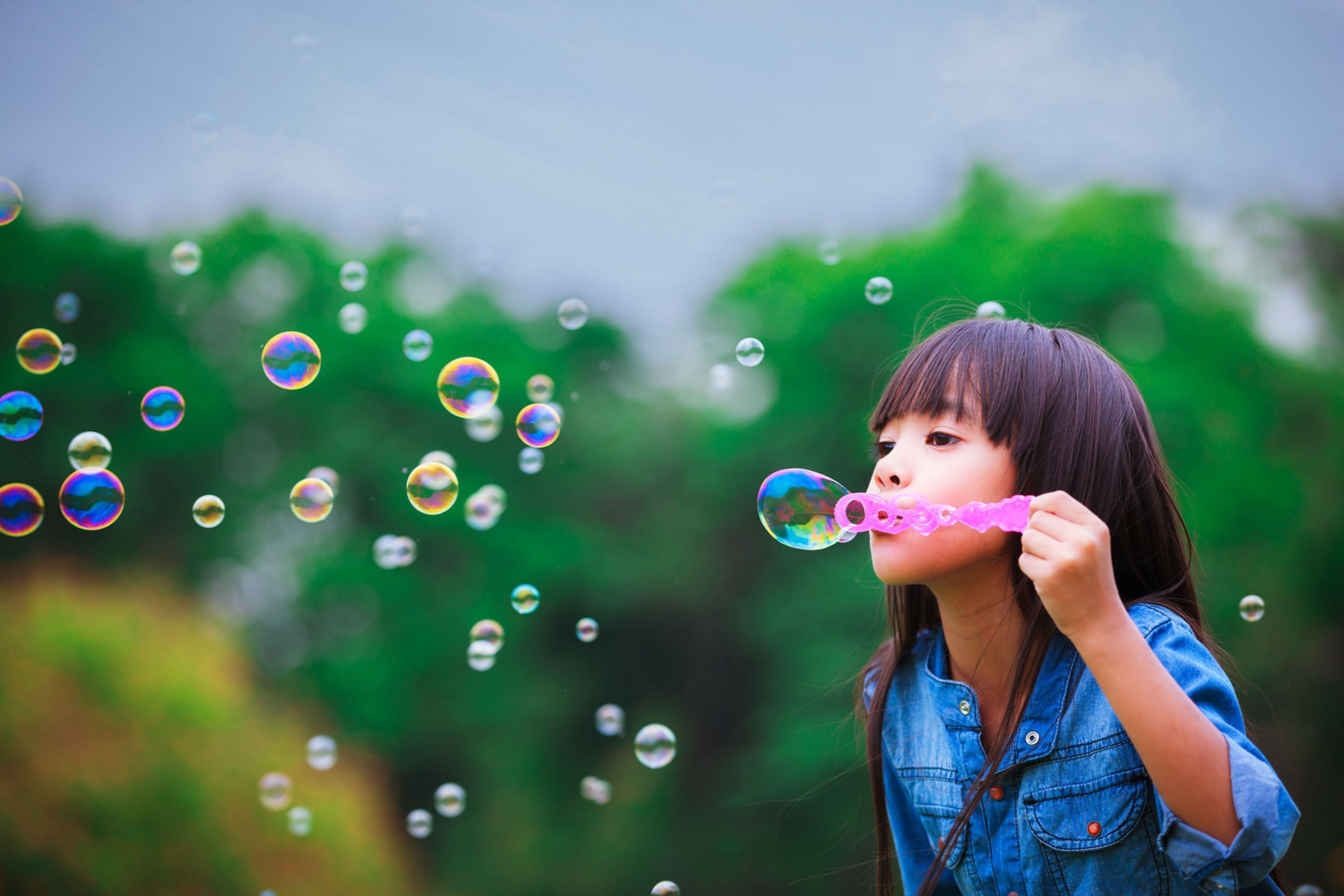 Child Girl Blowing Bubbles wallpaper thumb