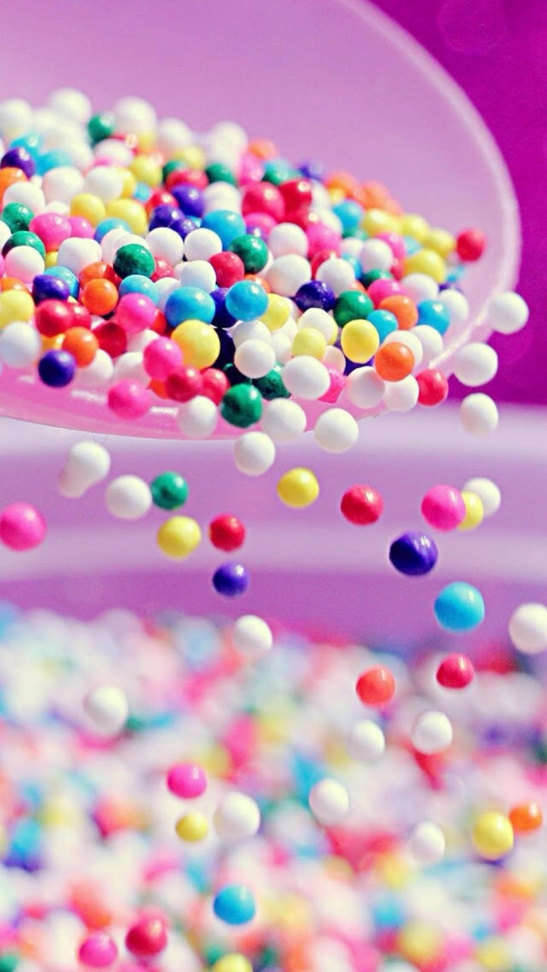 Sweet Colorful Candy Ball Shaking From Bowl iPhone wallpaper