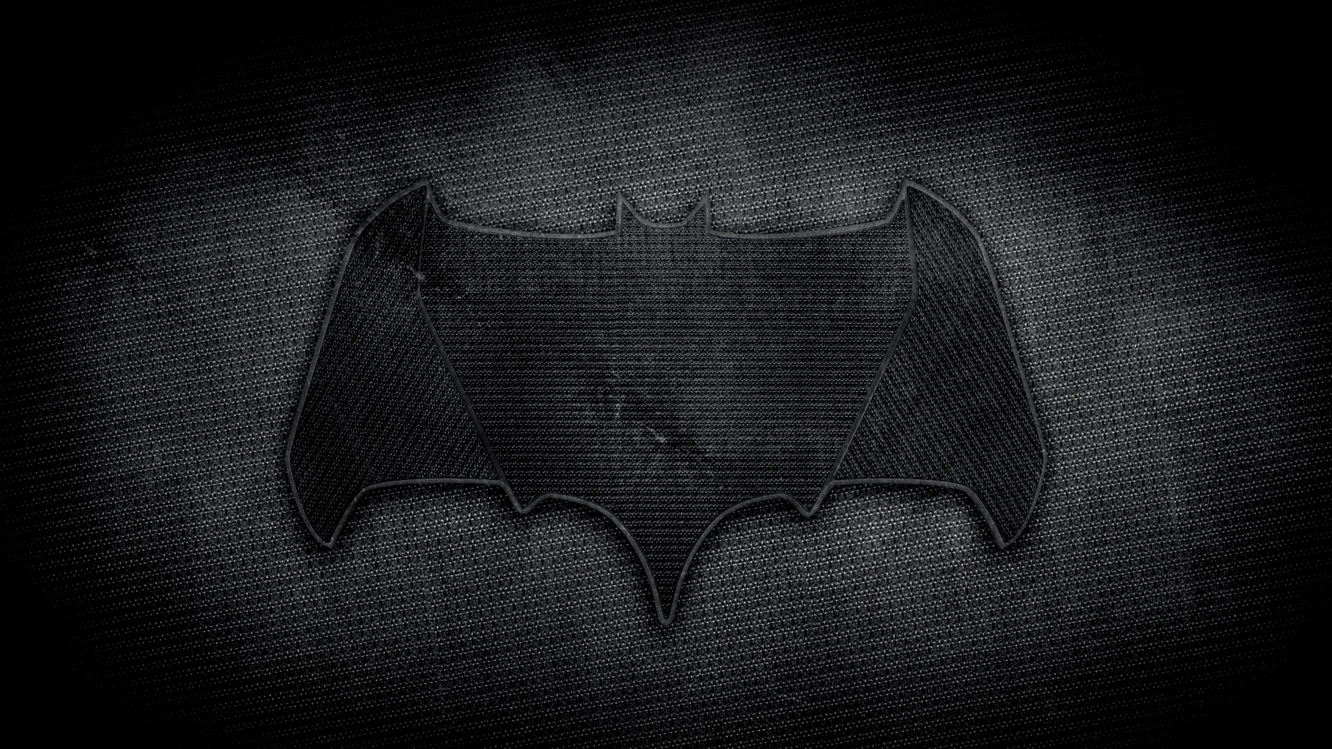 A sketch of what I think the bat symbol will look like based on