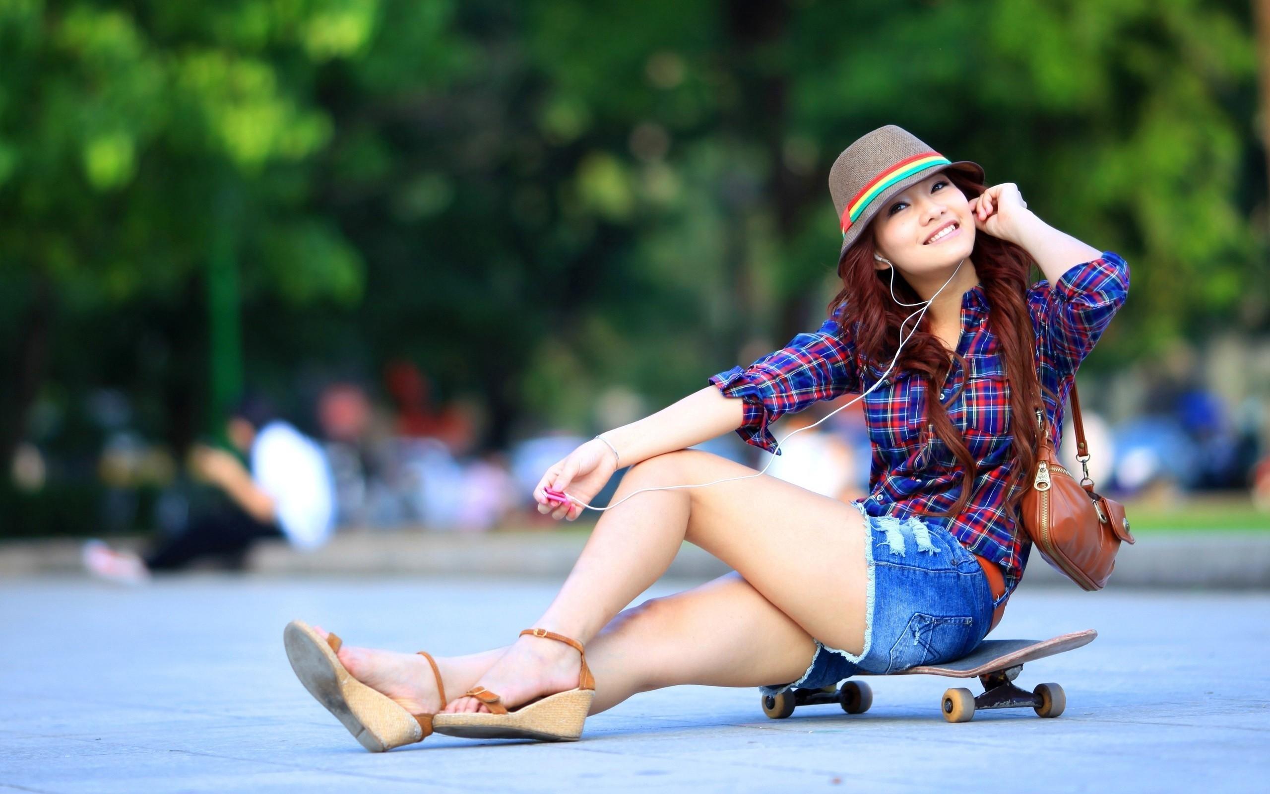 … Girl sitting on a skateboard