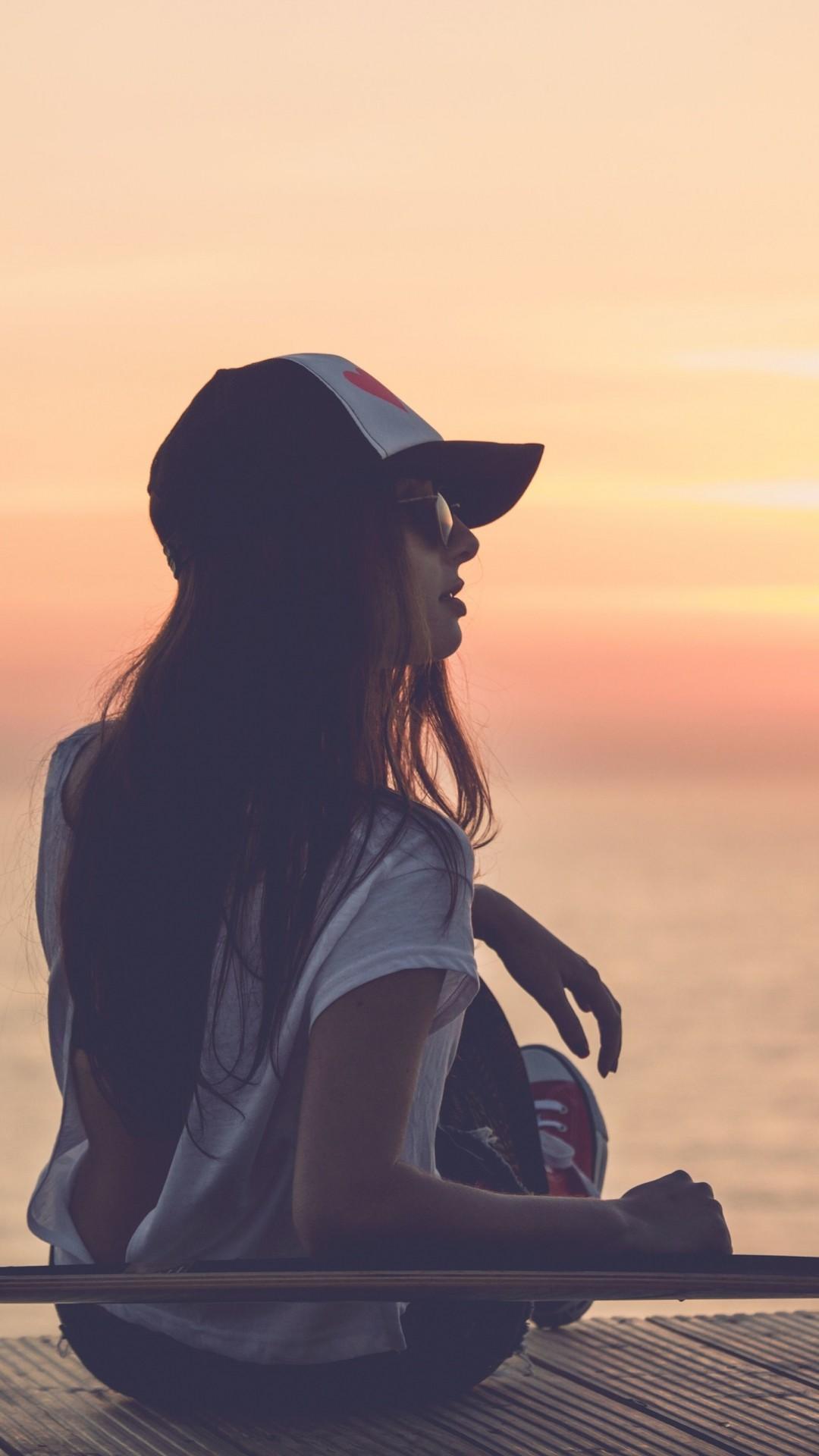 Preview wallpaper girl, skate, sea, sunset, cap 1080×1920