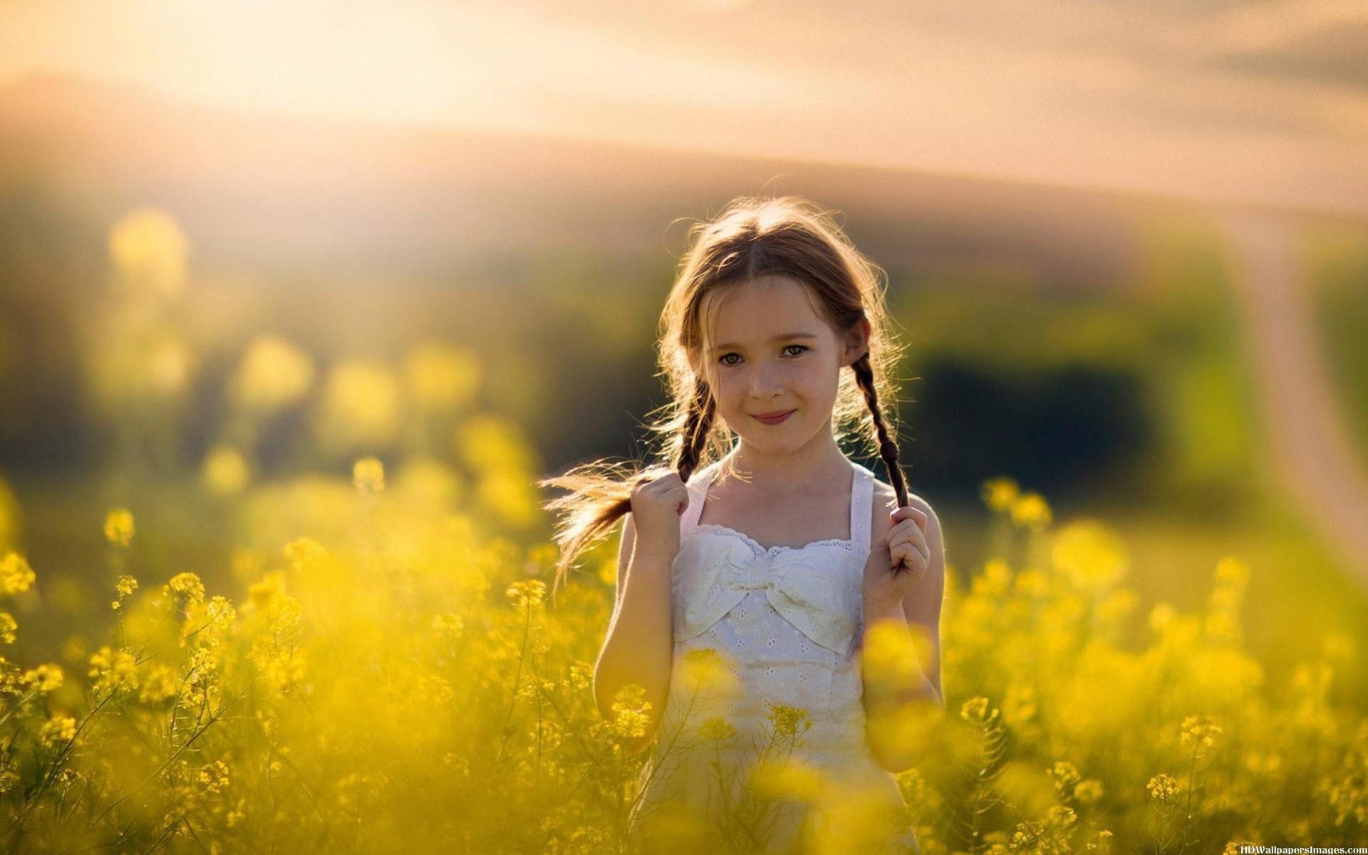 Cute Baby Girl in Yellow Flowers Field HD Desktop Wallpaper