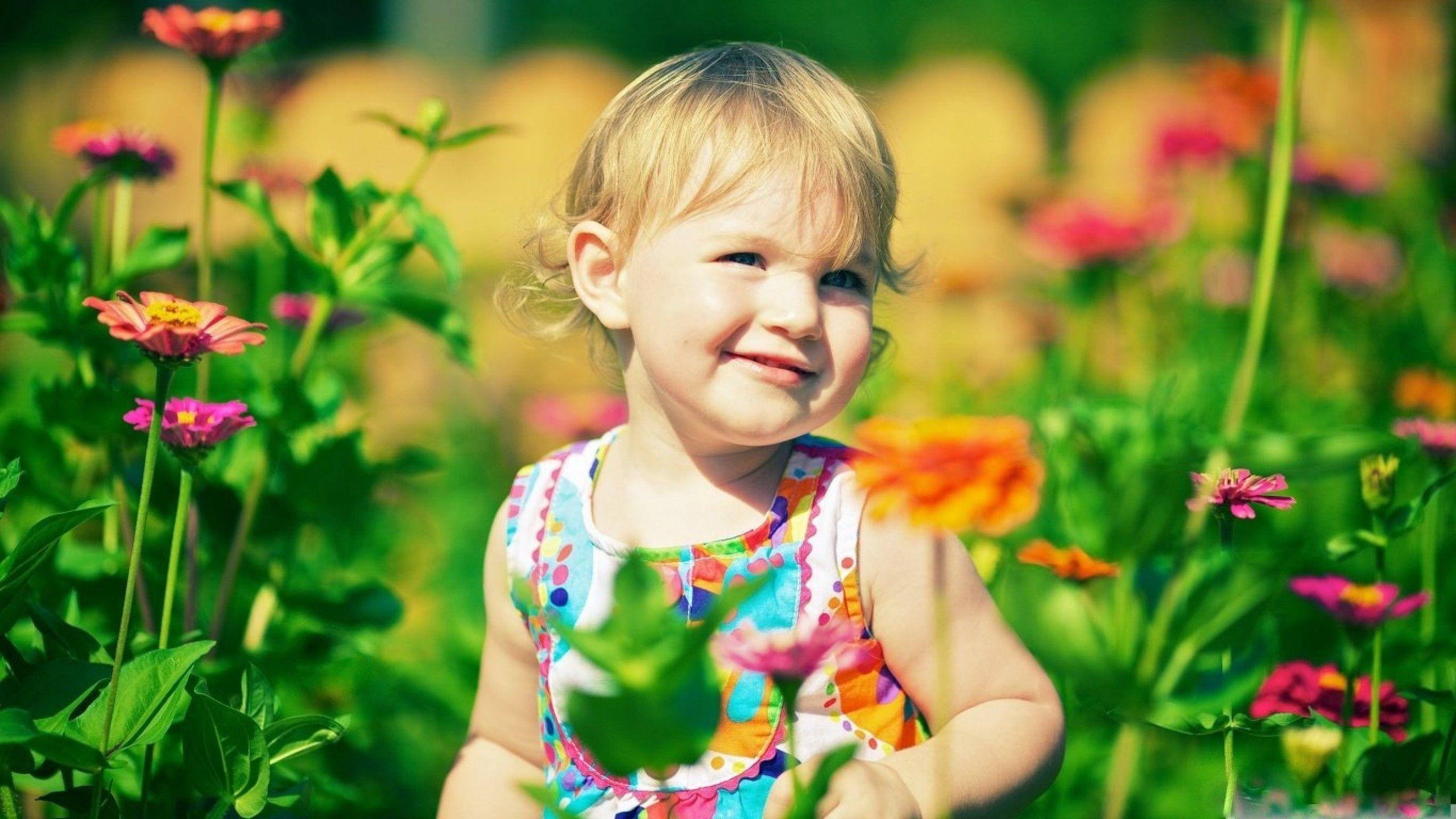 cute baby girl in zinnia flowers hd wallpaper