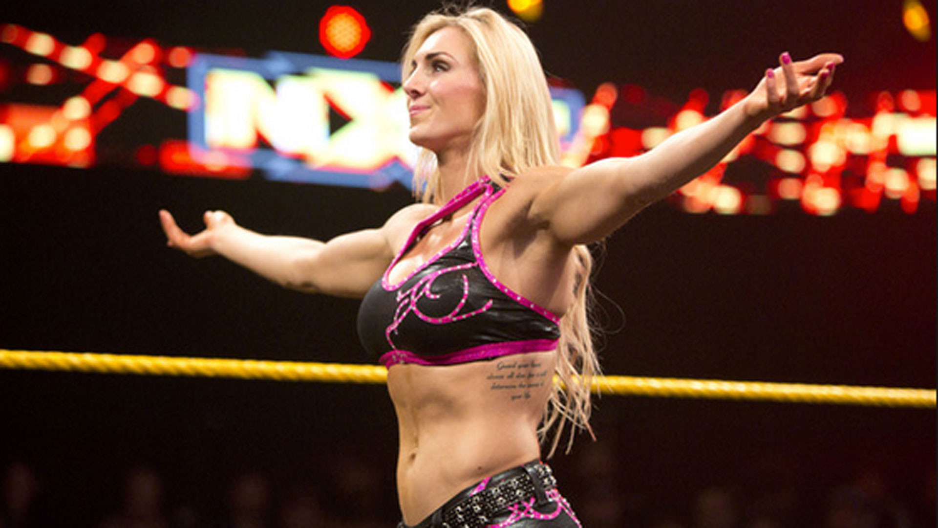 WWE Divas Champion Charlotte on #DivasRevolution, carrying on family  tradition   WWE   Sporting News