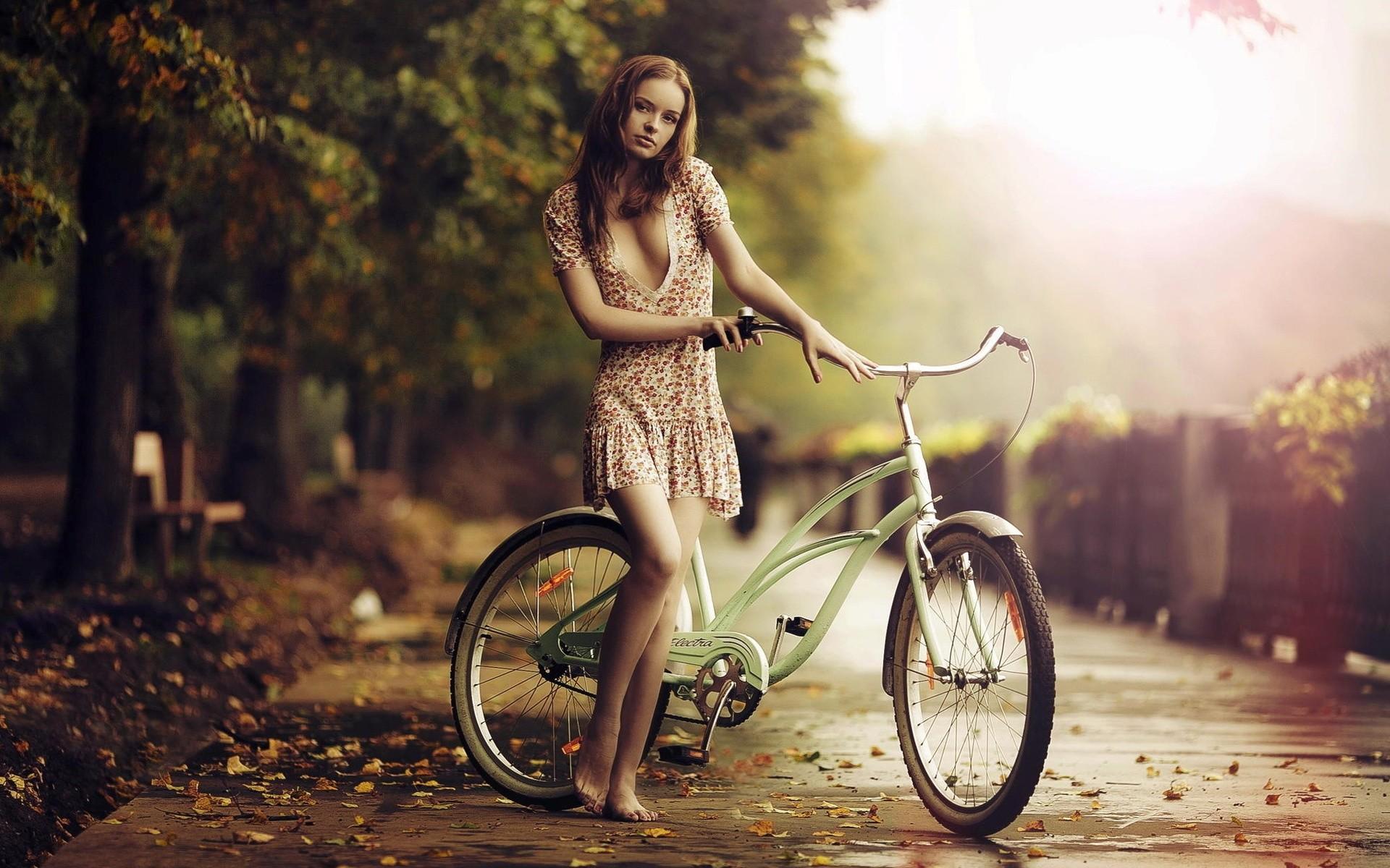 Girl On A Bike In Sunrise Wallpaper