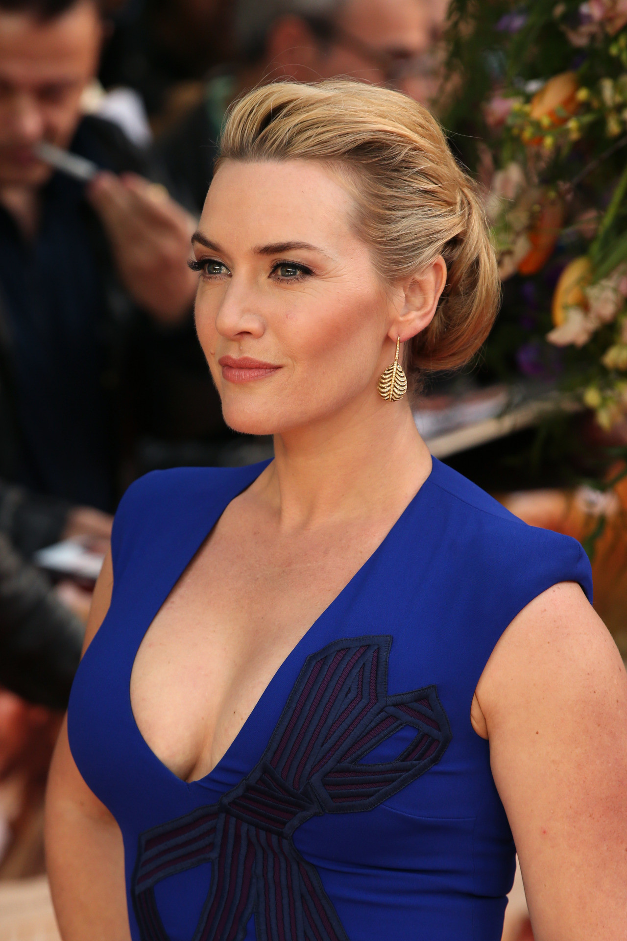 Kate Winslet lovely cleavage in a blue dress at movie premiere