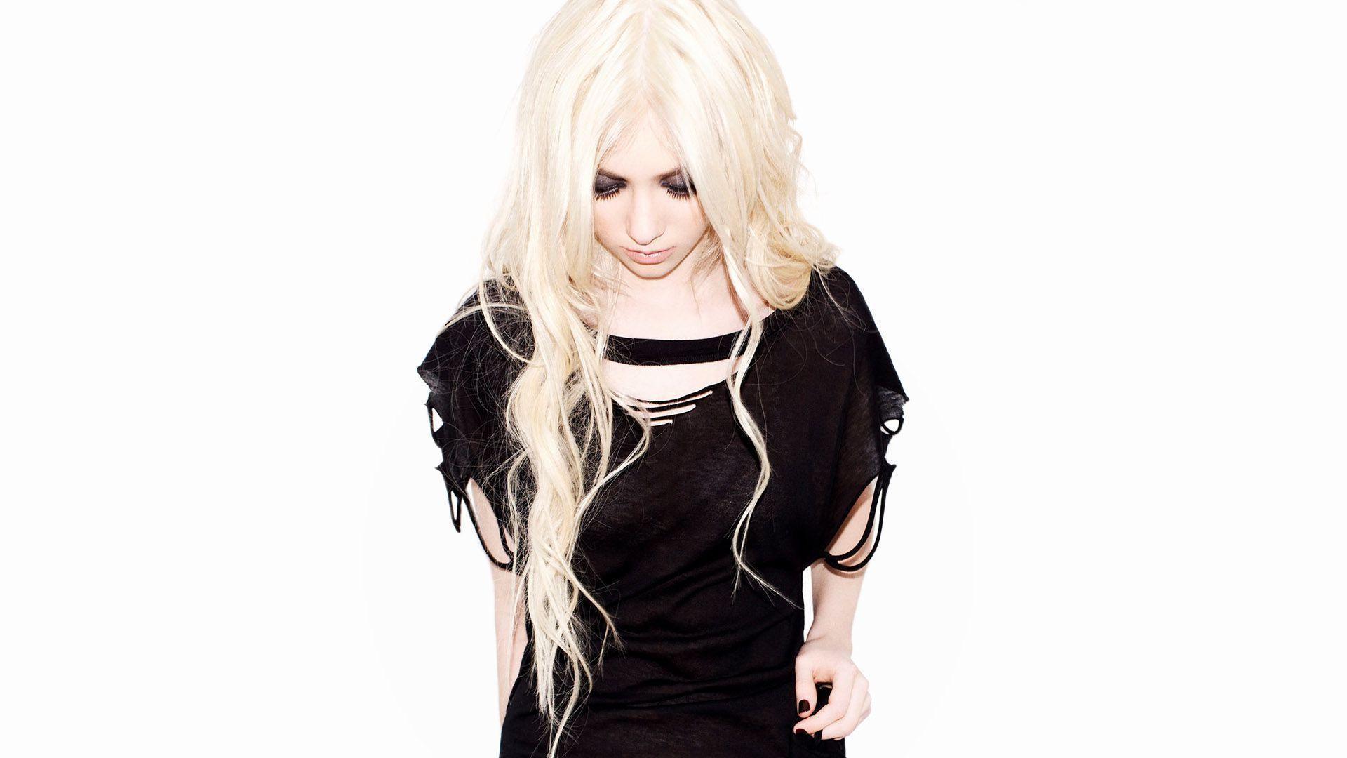 Taylor Momsen in a black blouse
