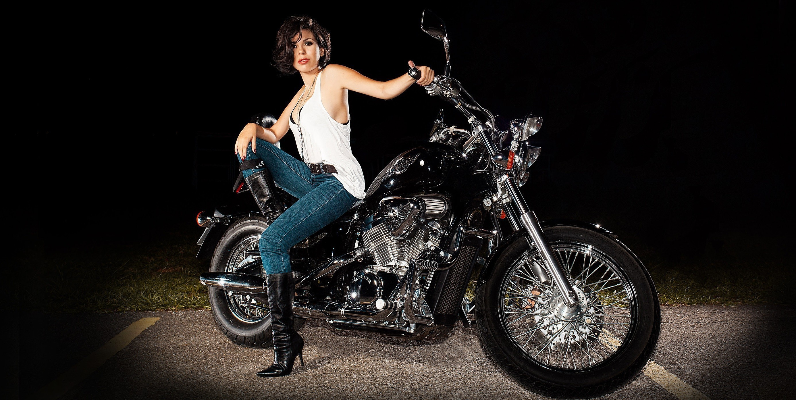 Girl model sitting on a motorcycle