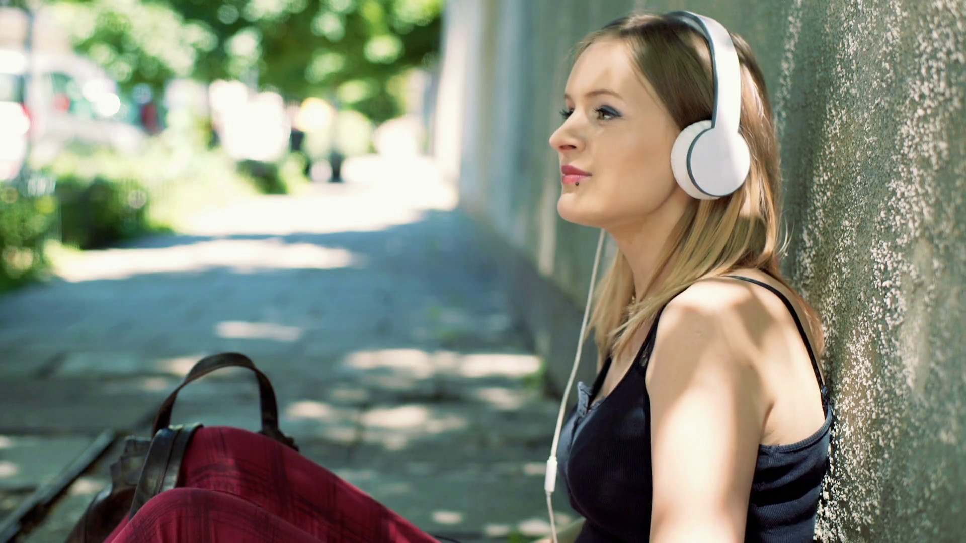 Punk girl sitting on the pathway and enjoying to listening music Stock  Video Footage – VideoBlocks