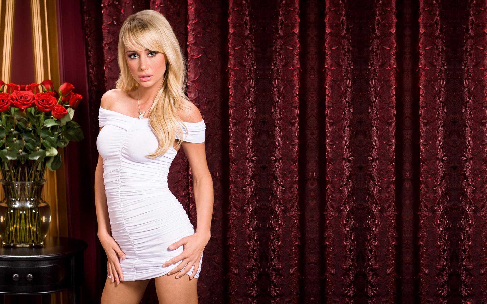 Sara Jean Underwood in a white dress