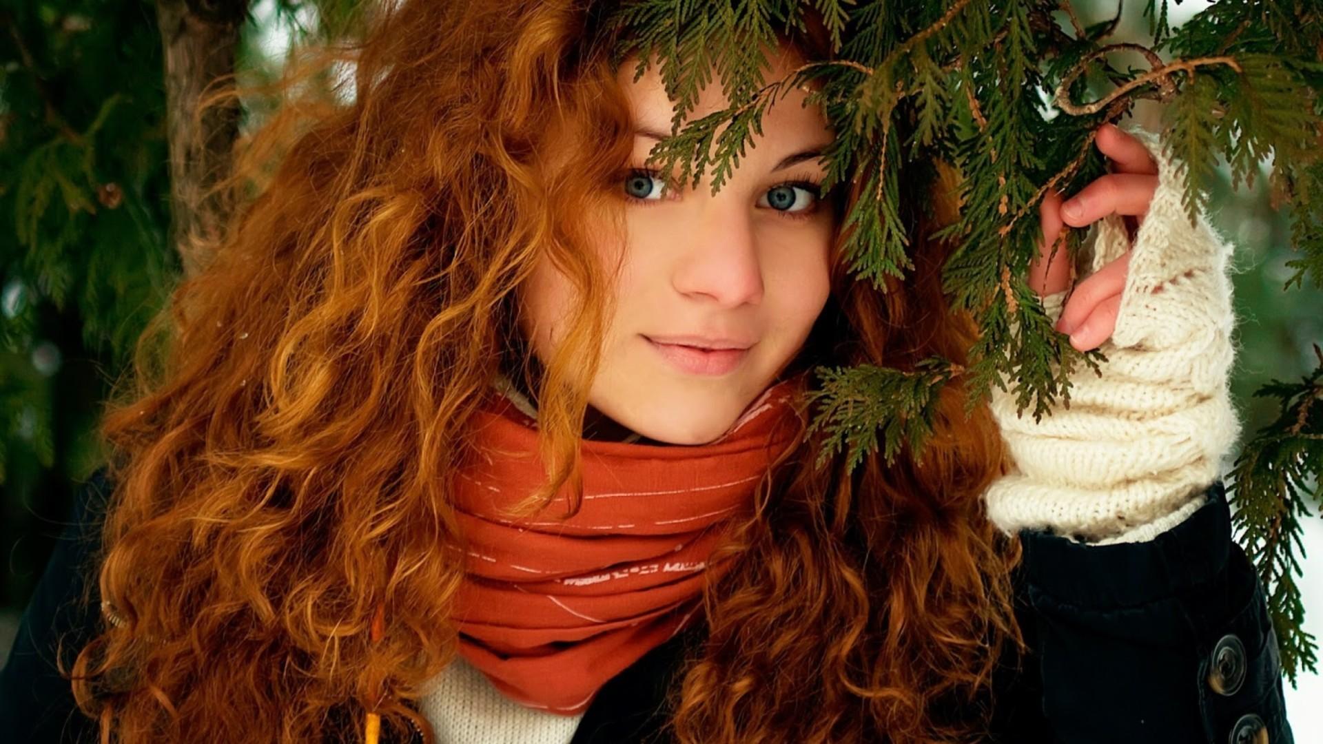 Red Head Girl Holding Branch