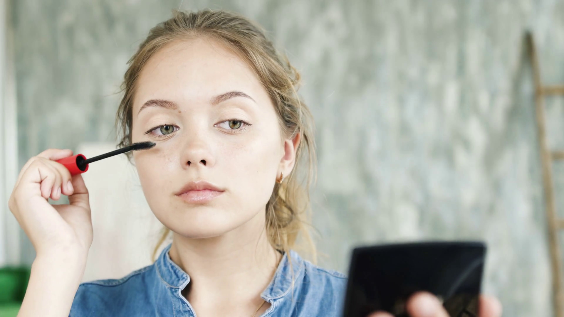 Cute teen girl applying make up. Cosmetic for skin care and health  complexion. Face painting and looking at the reflection. Happy good student  and first …